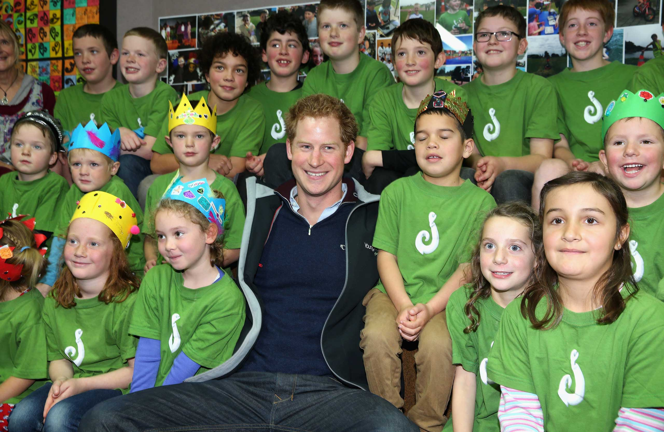 Prince Harry sits with pupils at Halfmoon Bay School in Oban, Stewart Island, New Zealand on May 11, 2015.