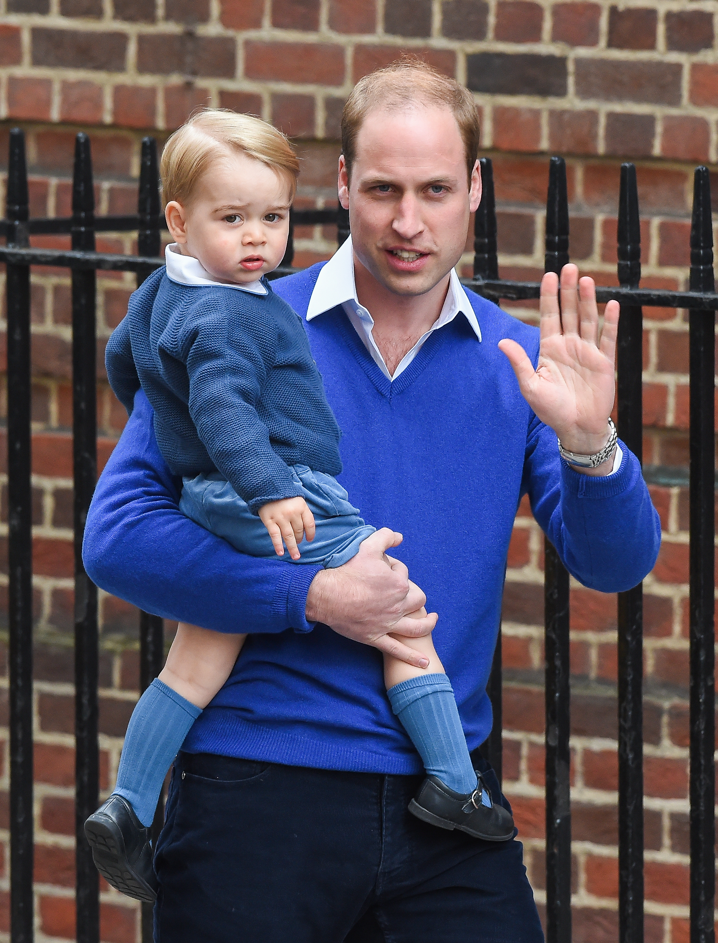 Prince William, Duke of Cambridge arrives with Prince George of Cambridge at the Lindo Wing following the birth his second child at St Mary's Hospital on May 2, 2015 in London.