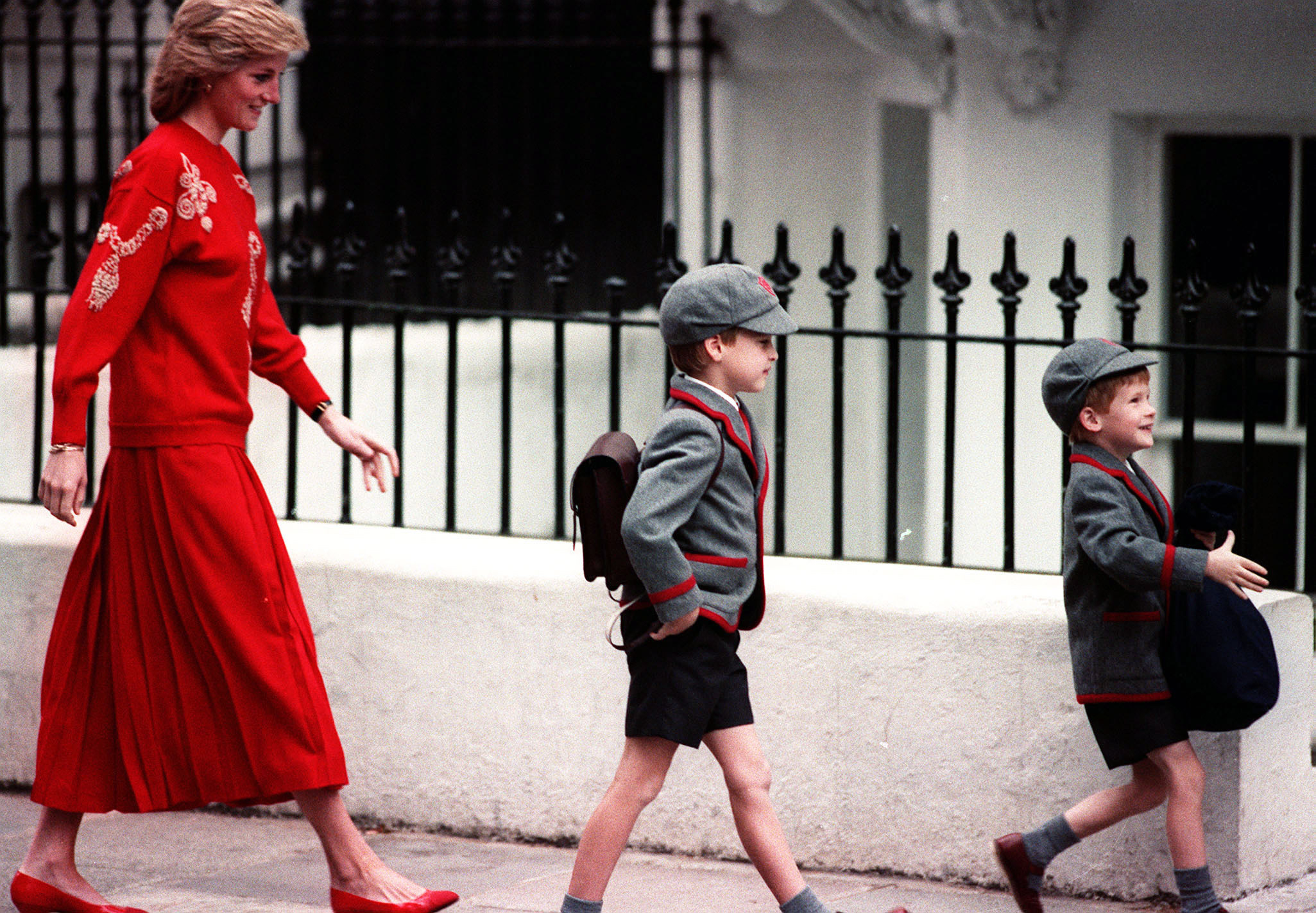 File photo dated Sept. 15, 1989 of the Princess of Wales following her sons Prince Harry (right), five years old, and Prince William, seven, on Harry's first day at the Wetherby School in Notting Hill, West London.