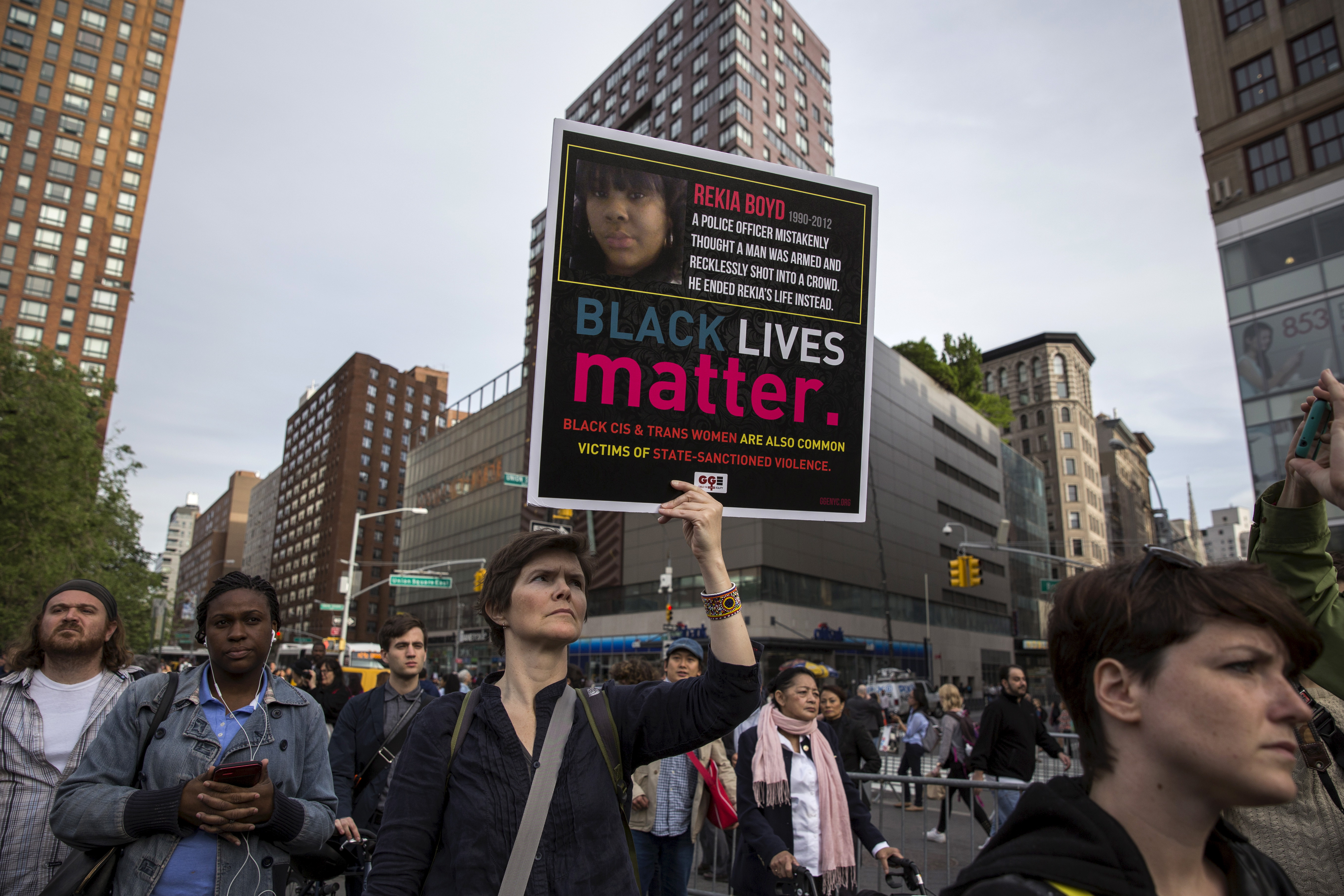 Activists hold placards as they take part in a vigil in what organizers said was in  remembrance of black women and girls killed by the police,  in Union Square, Manhattan, New York May 20, 2015