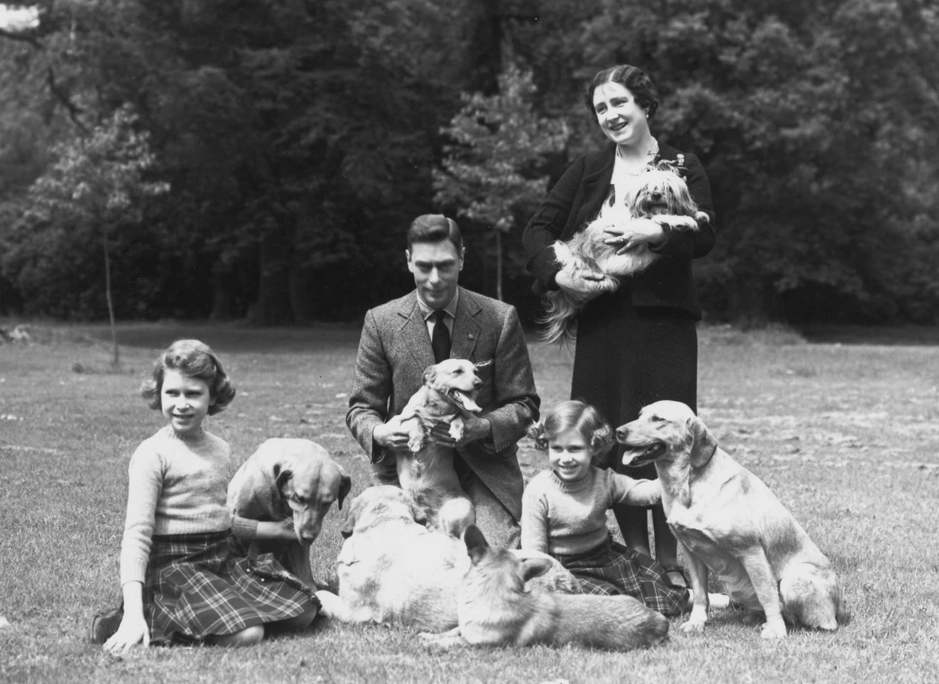 The family poses on the grounds of Windsor Castle in the English county of Berkshire in June 1936. With the arrival of Elizabeth's sister Princess Margaret Rose on Aug. 21, 1930, the family was complete.