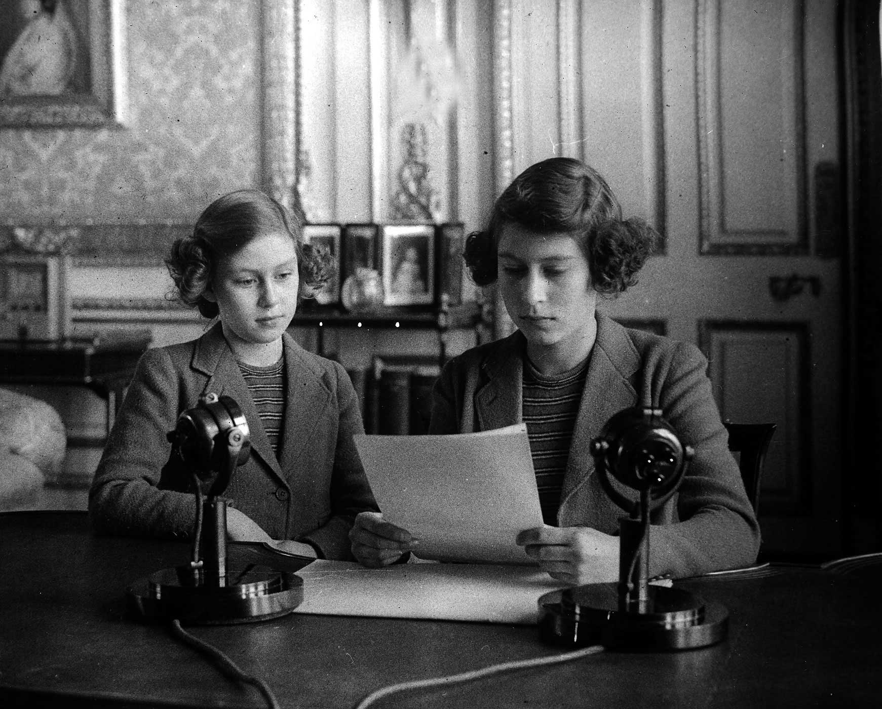 Princess Elizabeth (right) reads a broadcast in 1940 with her sister Princess Margaret at her side. The future Queen was making her first royal address to Britain and the Commonwealth during the BBC's Children's Hour. She sent her best wishes to all the children who had been sent overseas to Canada, Australia, New Zealand and the U.S. for safety during the war.