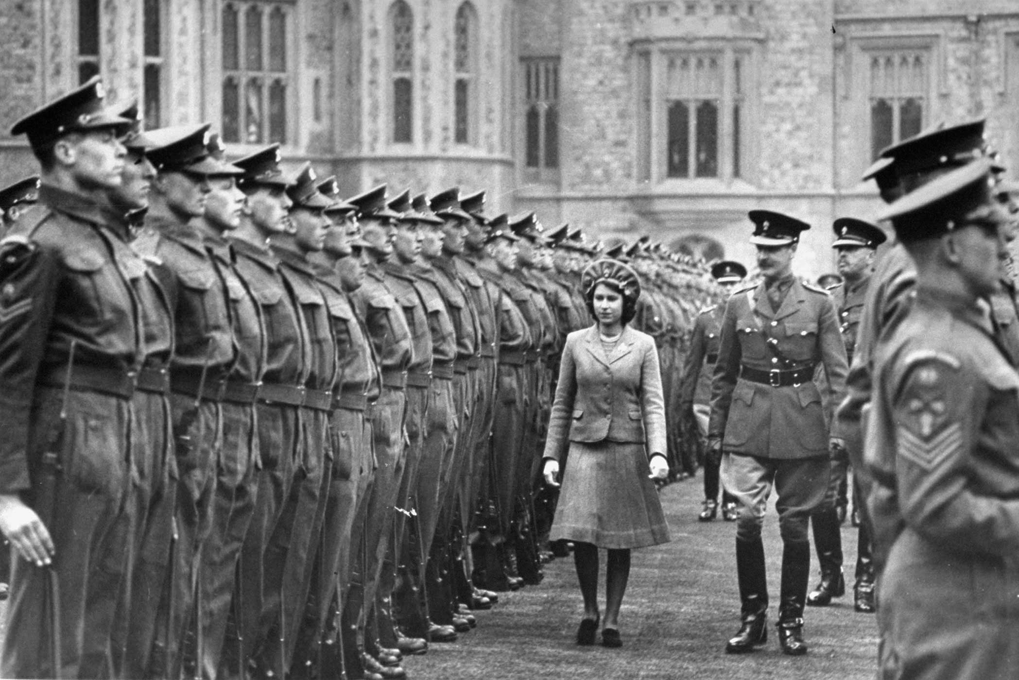 Princess Elizabeth, on her 16th birthday on April 21, 1942, reviews the Grenadier Guards, the most senior regiment of the British infantry. She was appointed as the Colonel-in-Chief as part of her expanding royal duties.