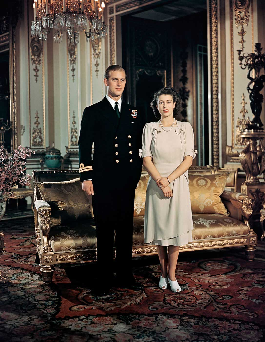 Princess Elizabeth stands with her fiancé, Lieutenant Philip Mountbatten, Prince of Greece and Denmark, at Buckingham Palace on Aug. 19, 1947. Though the pair had known each other for years and were very much in love, their engagement sparked some controversy. To appease critics, foreign-born Philip renounced his Greek and Danish titles and converted to Anglicanism.