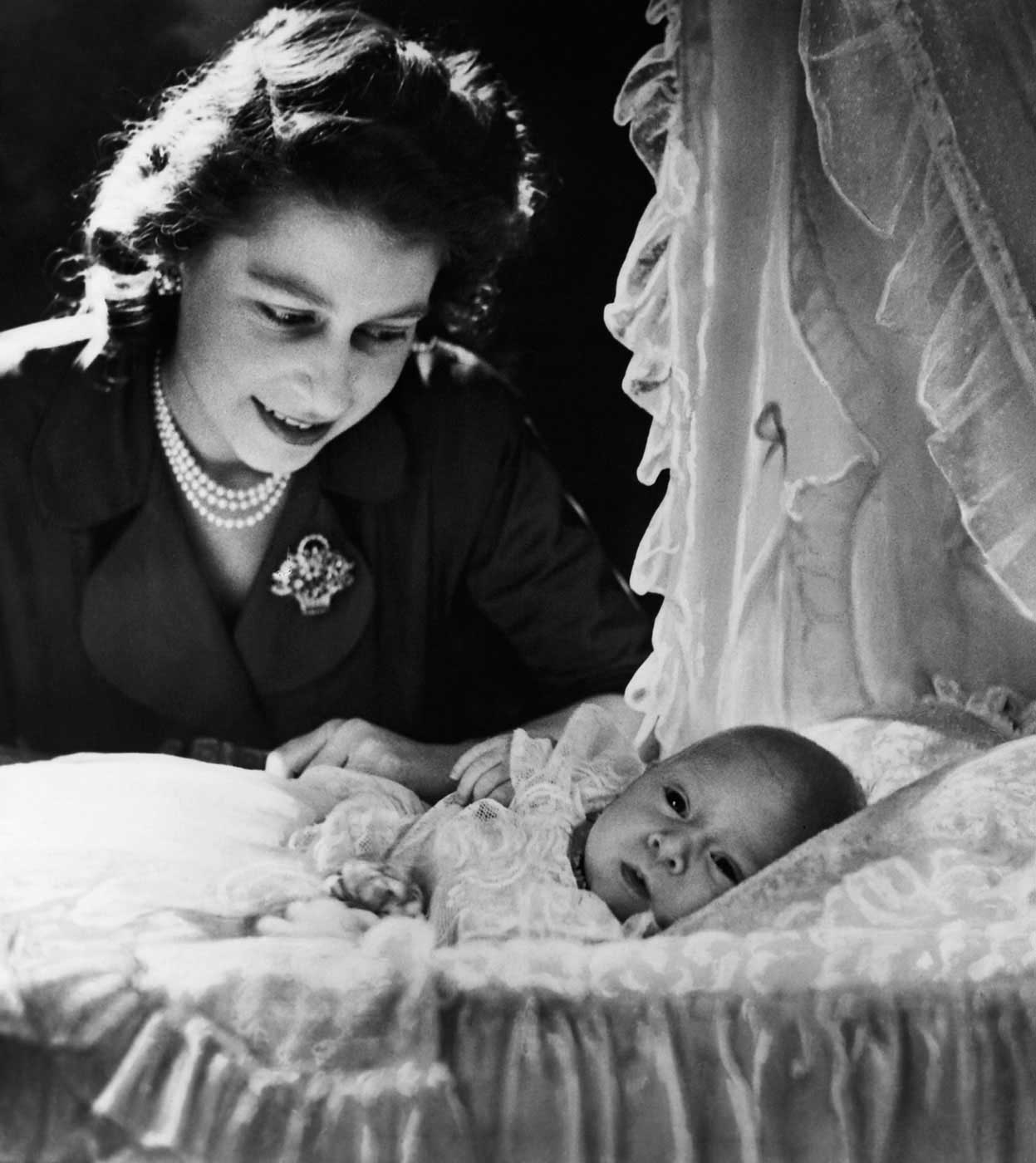 Princess Elizabeth with her 1-month-old son Prince Charles of Edinburgh in London on Dec. 21, 1948. Charles was born shortly after Elizabeth's father stated that the couple's children would be bestowed with the titles of prince and princess, even though Philip was no longer a royal prince.