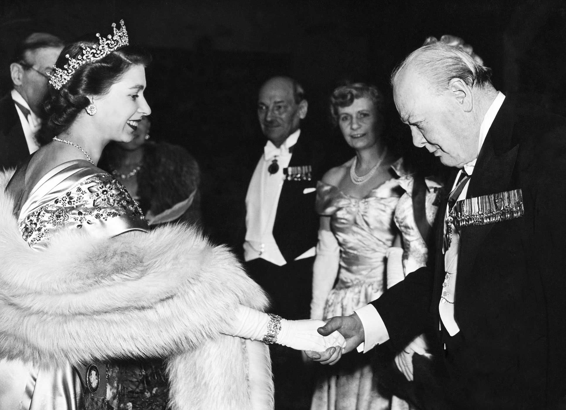 Princess Elizabeth greets Winston Churchill at Guildhall on March 23, 1950. Under her reign as Queen, Elizabeth has seen 13 Prime Ministers, including Churchill, from both the Tory and Labour parties.