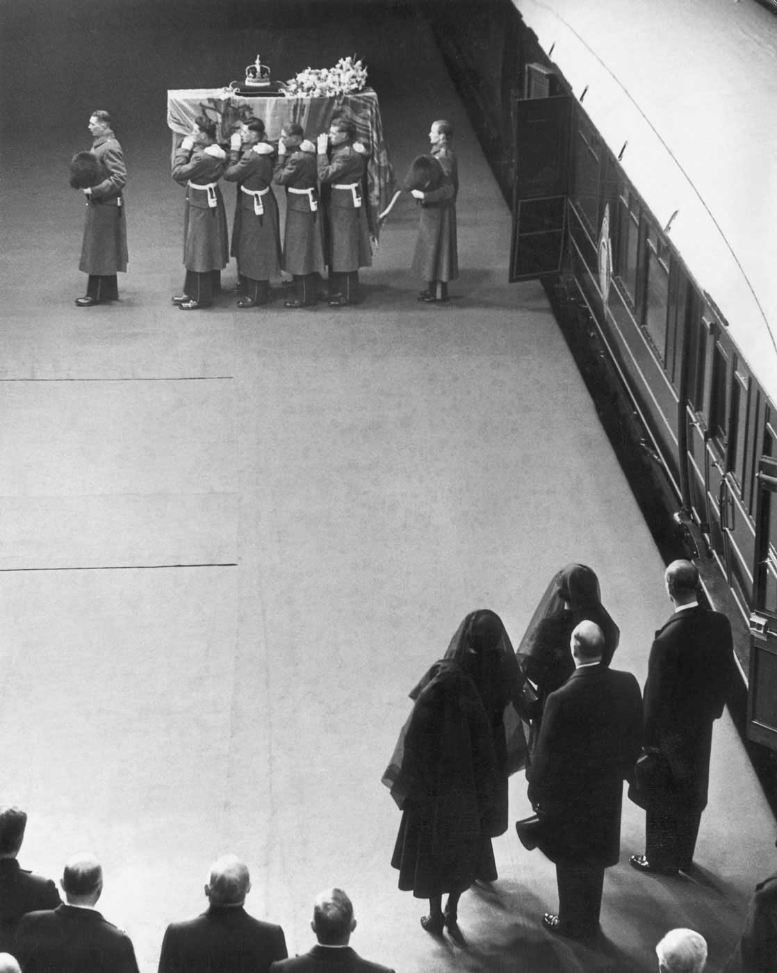 Princess Elizabeth, along with her mother, sister and husband, watches as her father's coffin is lifted from a train before heading to Westminster on Feb. 11, 1952. When King George VI's health started to decline the previous year, Elizabeth began standing in his place for royal duties. She and Prince Philip were abroad in Kenya on one such mission when word came that the King had passed away on Feb. 6. Elizabeth was immediately proclaimed the Queen.