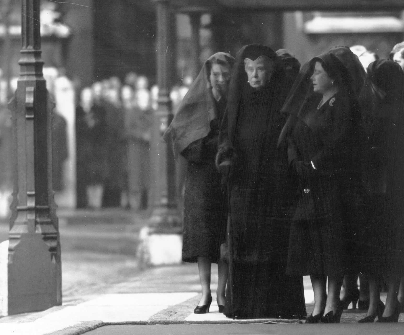 Elizabeth, her grandmother Queen Mary and her mother Queen Elizabeth stand in mourning at the funeral of King George VI. The following year, just 10 weeks before Elizabeth's official coronation, Queen Mary would pass away from lung cancer at the age of 85. Before her death, she insisted that the coronation not be postponed.