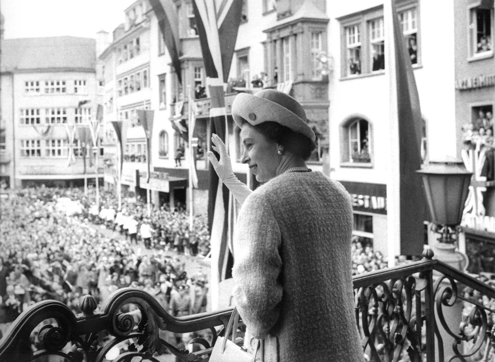 Queen Elizabeth II waves to onlookers from a balcony in Bonn, Germany, on May 19, 1965. The Queen and her husband were on an 11-day state visit. Throughout her time as Queen, Elizabeth would become the most widely traveled of any previous monarch.