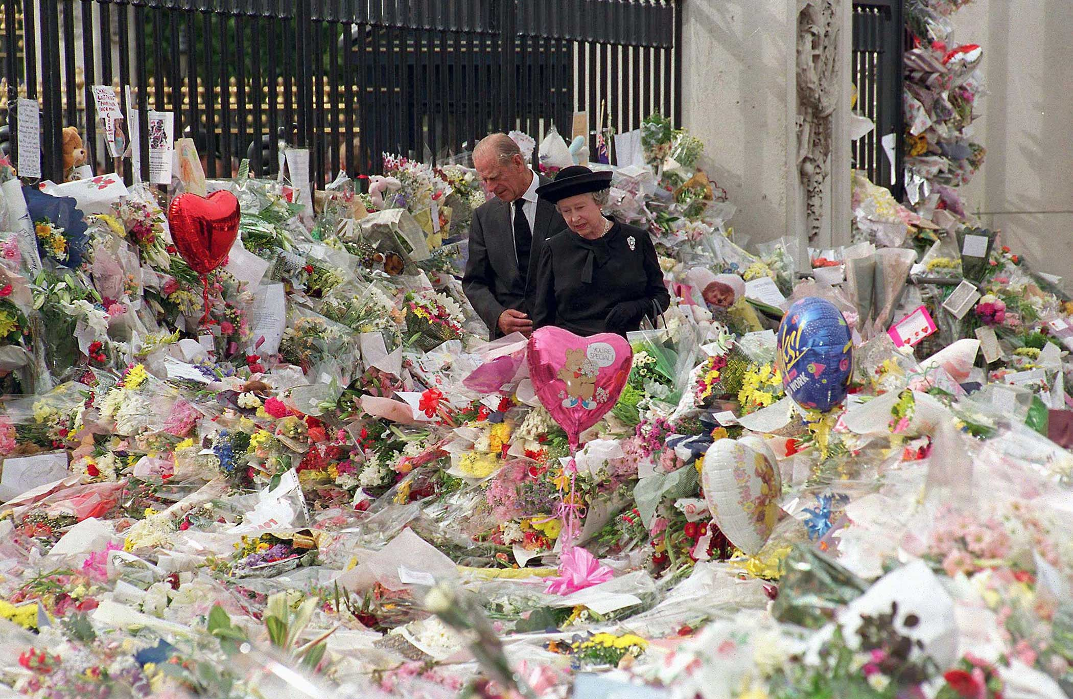 The Queen, along with Prince Philip, survey the flowers left in tribute to Diana, Princess of Wales, on Sept. 5, 1997, the eve of her funeral. Diana was killed in a car crash in Paris the week before, and although she was no longer married to Prince Charles, as the mother of Princes William and Harry, she was honored with a national public funeral.