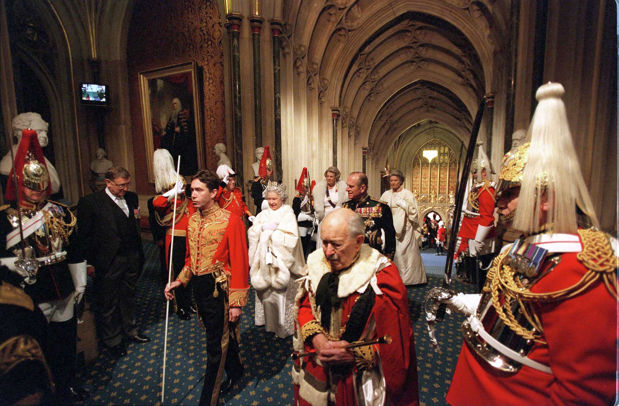 The Queen, with Prince Philip, is led by the Marquess of Cholmondeley and the Duke of Norfolk during an event that marks the beginning of a session of Parliament. Throughout her reign, Queen Elizabeth II has opened every session, except in 1959 and 1963, years when she was pregnant.