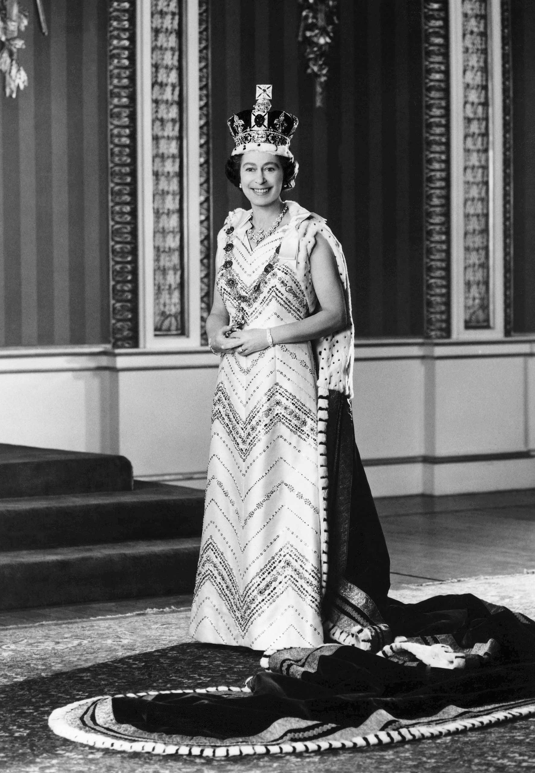 Queen Elizabeth II, dressed in royal regalia, posed for this special Jubilee picture in the Throne Room of Buckingham Palace, after she had delivered the traditional Queen's speech at the 1976 official State Opening of Parliament.