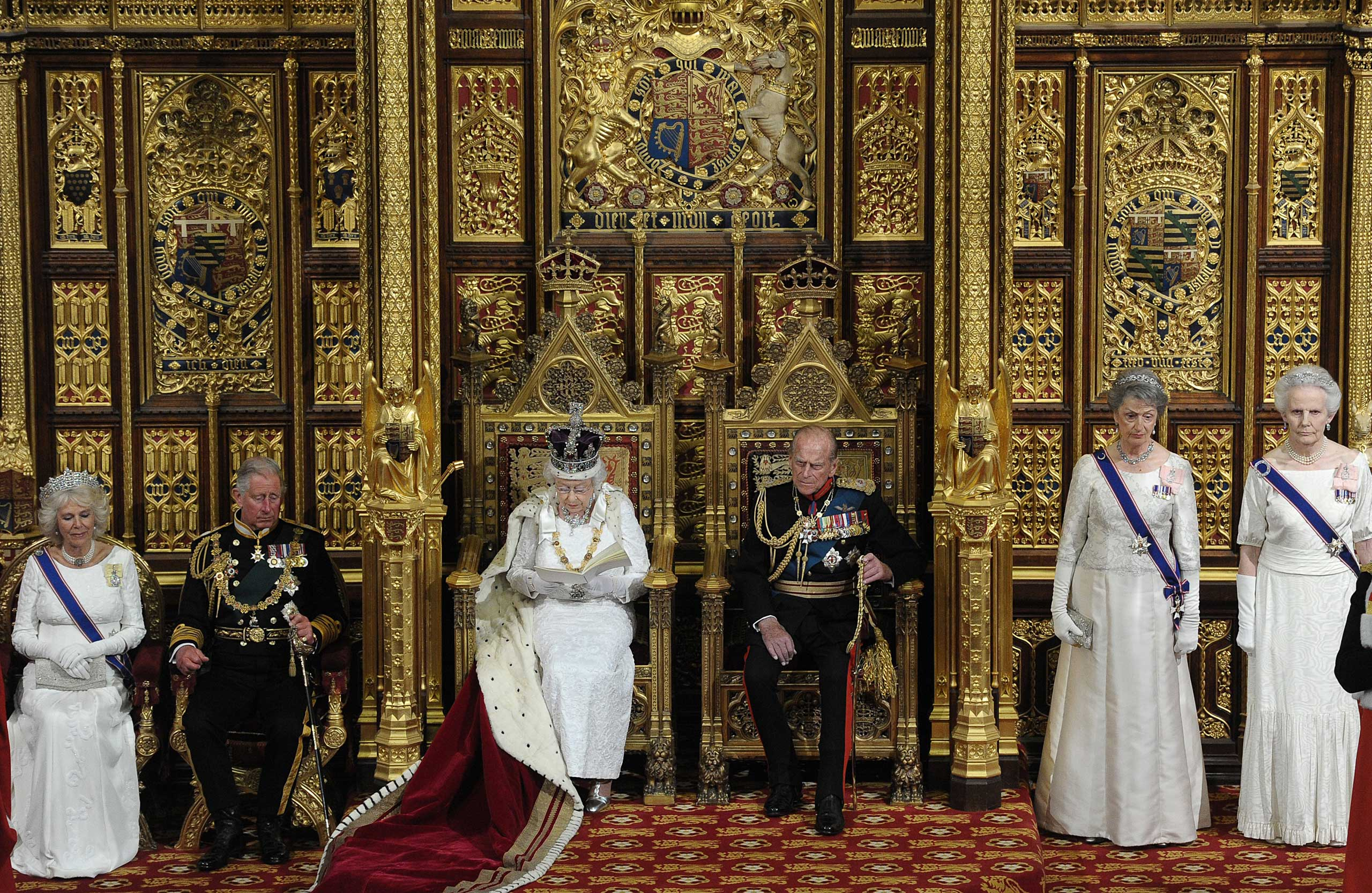Queen Elizabeth II delivers the Queen's Speech from the Throne in the House of Lords next to Prince Philip, Duke of Edinburgh, Britain's Camilla, Duchess of Cornwall and Prince Charles, Prince of Wales during the State Opening of Parliament at the Palace of Westminster in London in 2014.