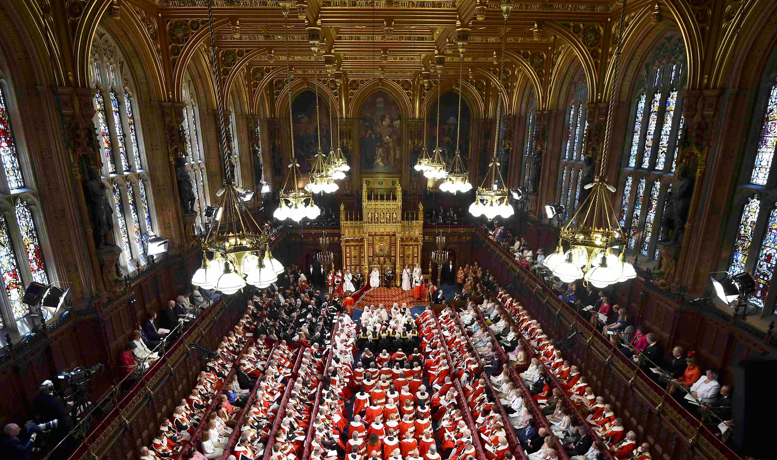 Queen Elizabeth II delivers the Queen's Speech next to Prince Phillip during the State Opening of Parliament in the Palace of Westminster in London on May  27, 2015.