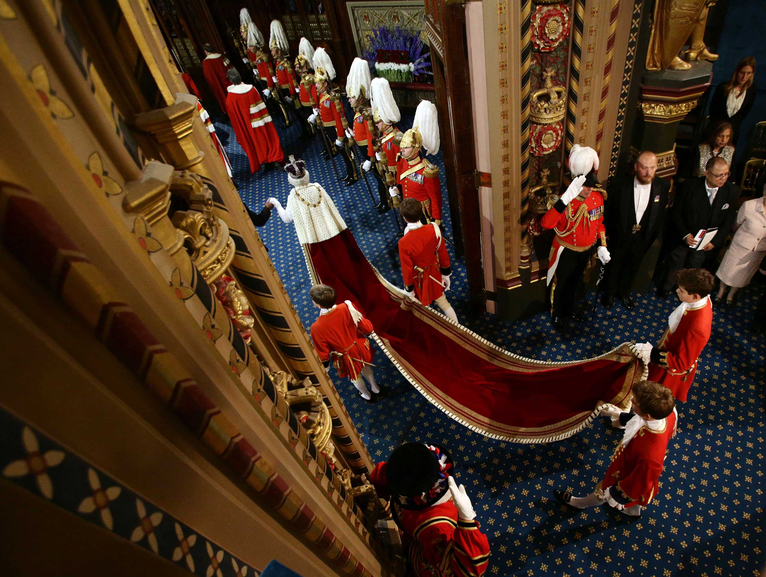 Queen Elizabeth II and the Prince Philip, Duke of Edinburgh proceed through the Royal Gallery during the State Opening of Parliament in the House of Lords at the Palace of Westminster in London in 2014.