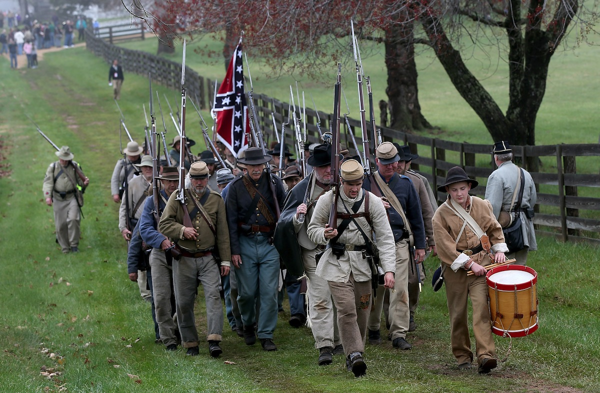 American Civil War re-enactors acting as members of the North Carolina 26th Infantry are led by a drummer on April 9, 2015 in Appomattox, Va.