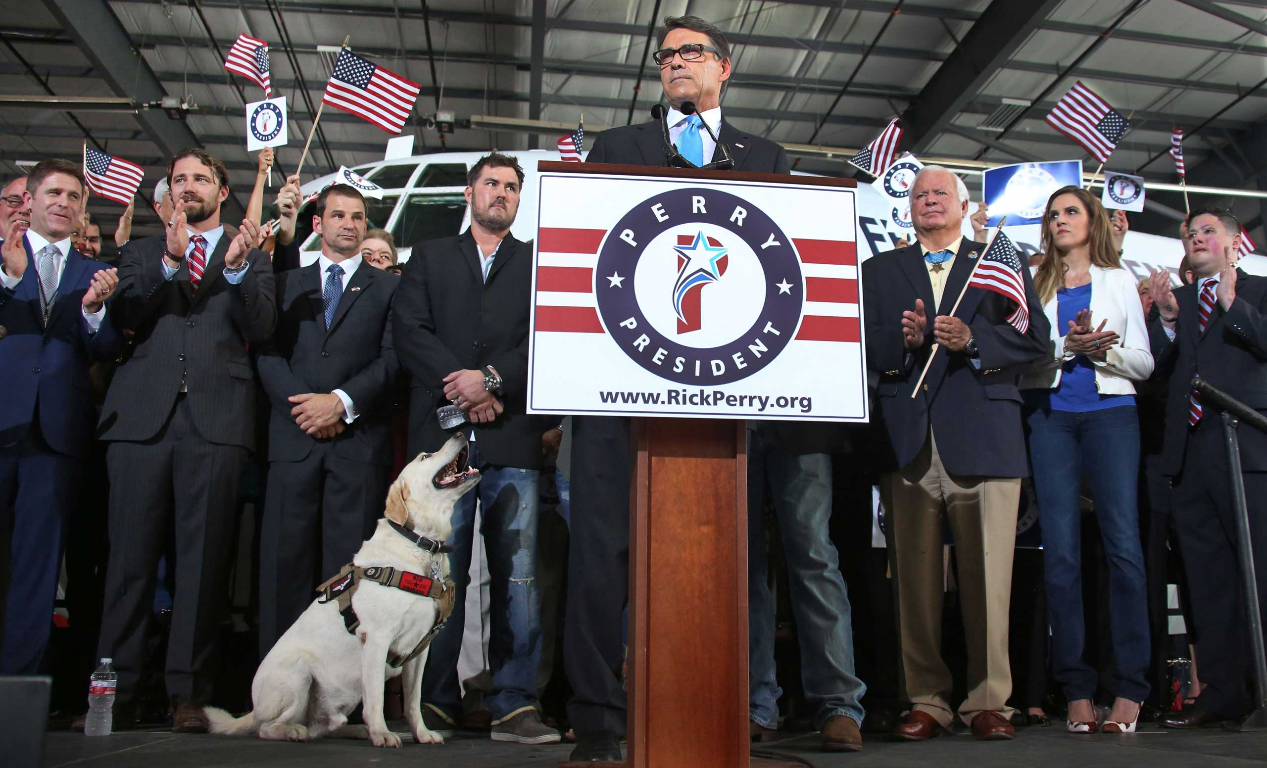 Former Texas governor Rick Perry announces his candidacy for Republican presidential nominee at an event held at Addison Airport in Addison, Texas on Thursday, June 4, 2015.