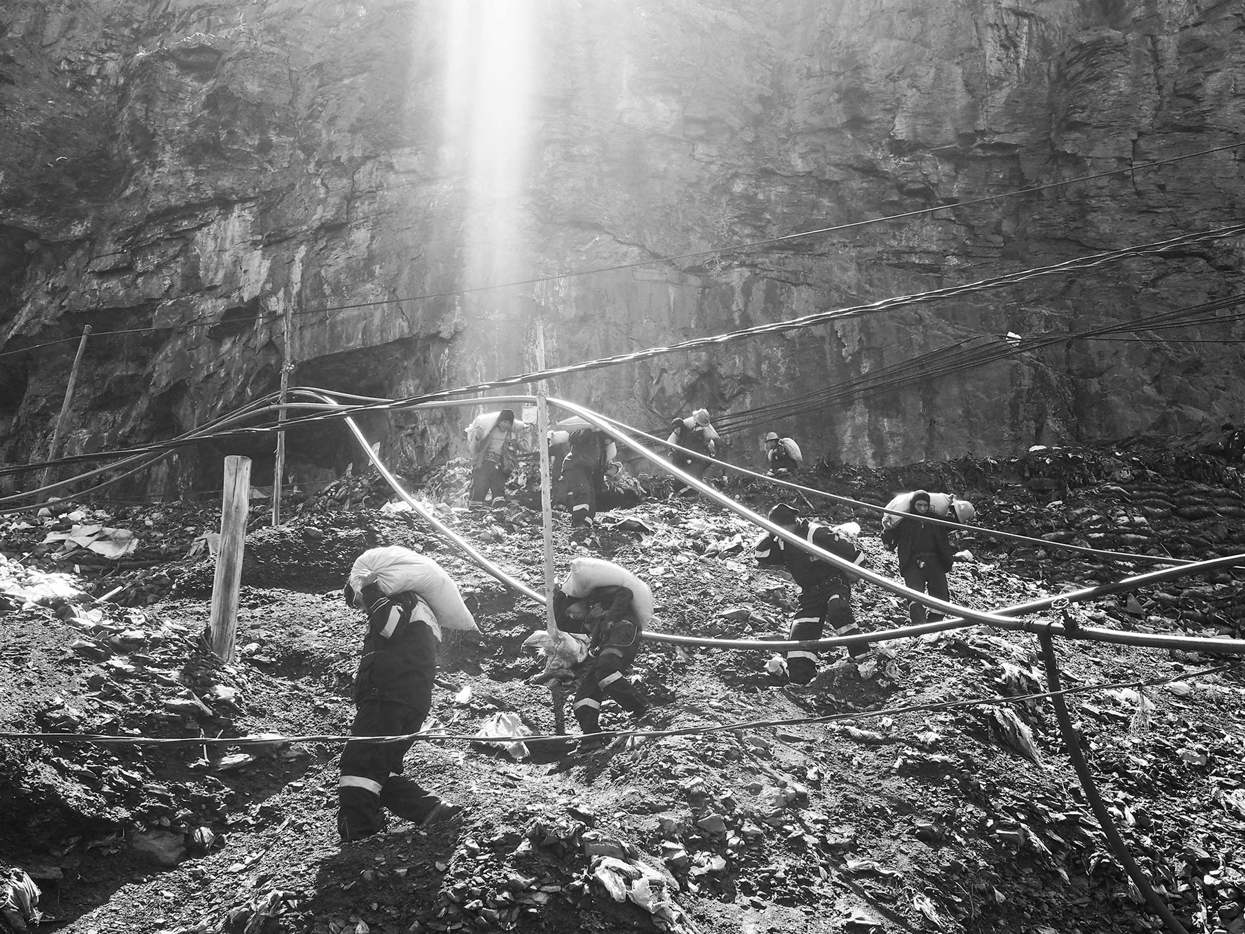 The New Yorker Photo Booth: Digging for Gold in the AndesMiners return home carrying bags filled with rocks, some of which may contain gold. The mines operate on an ancient labor system called cachorreo, which is usually described as thirty days of unpaid work followed by a single frantic day in which workers get to keep whatever gold they can haul out for themselves.