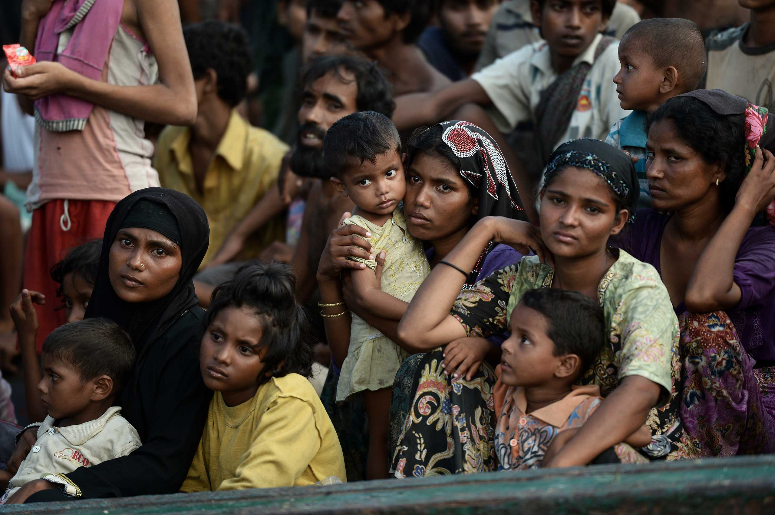 Rohingya migrants sit on a boat drifting in Thai waters off the southern island of Koh Lipe in the Andaman sea on May 14, 2015.