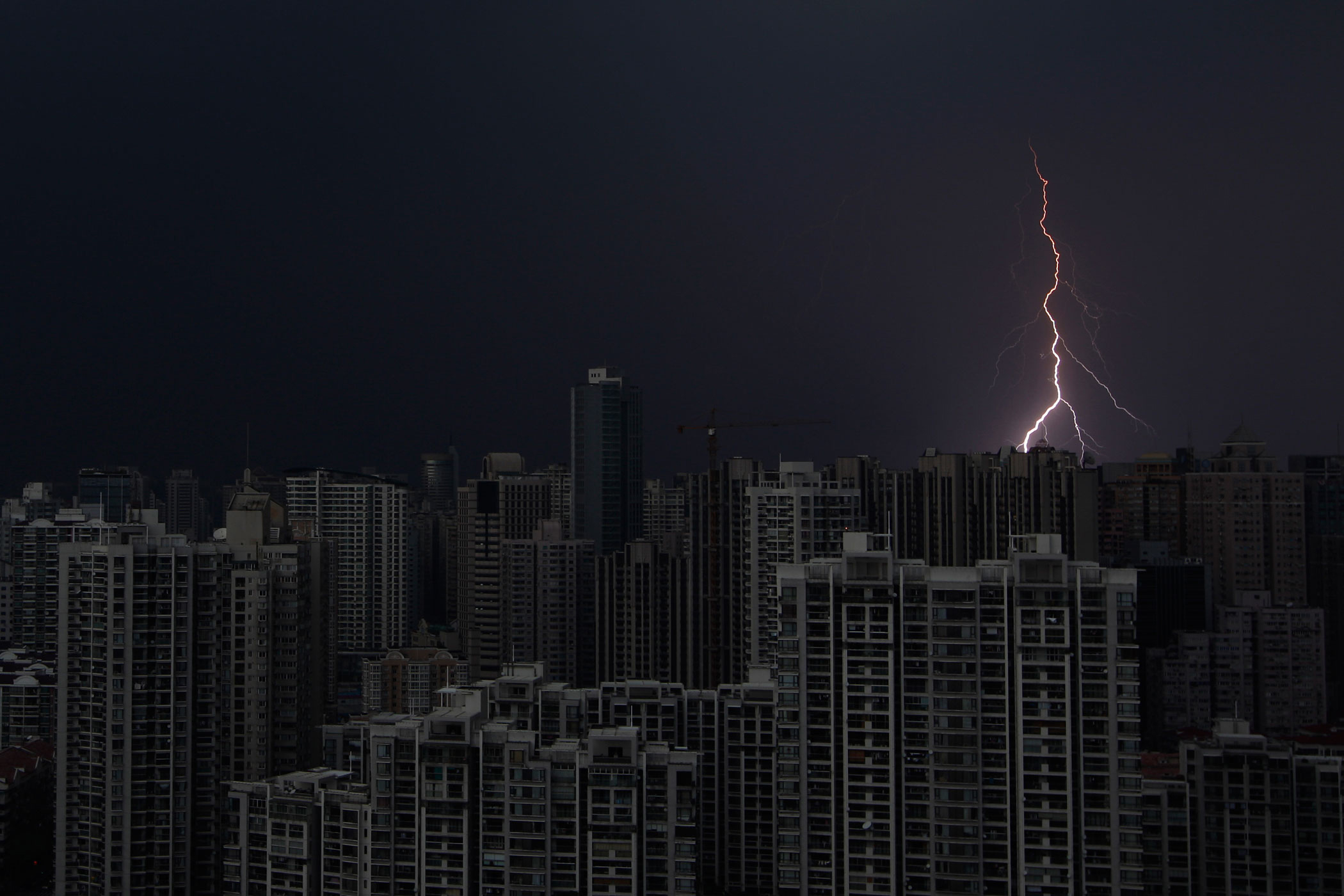 Lightning is seen above buildings during a storm in central Shanghai, Aug. 15, 2012.