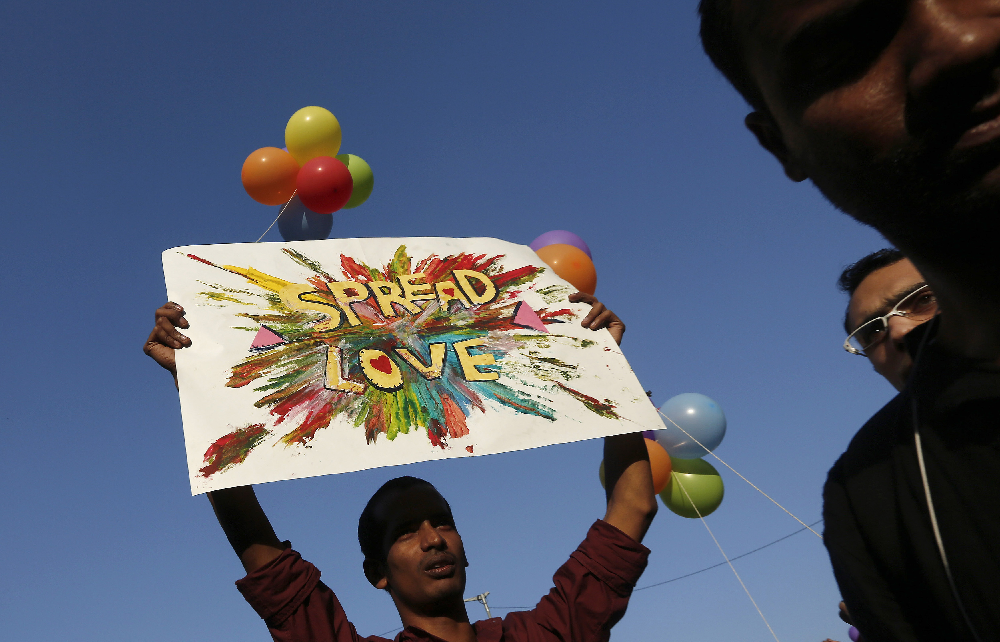 A participant holds a placard during Delhi Queer Pride Parade, an event promoting gay, lesbian, bisexual and transgender rights, in New Delhi on Nov. 30, 2014