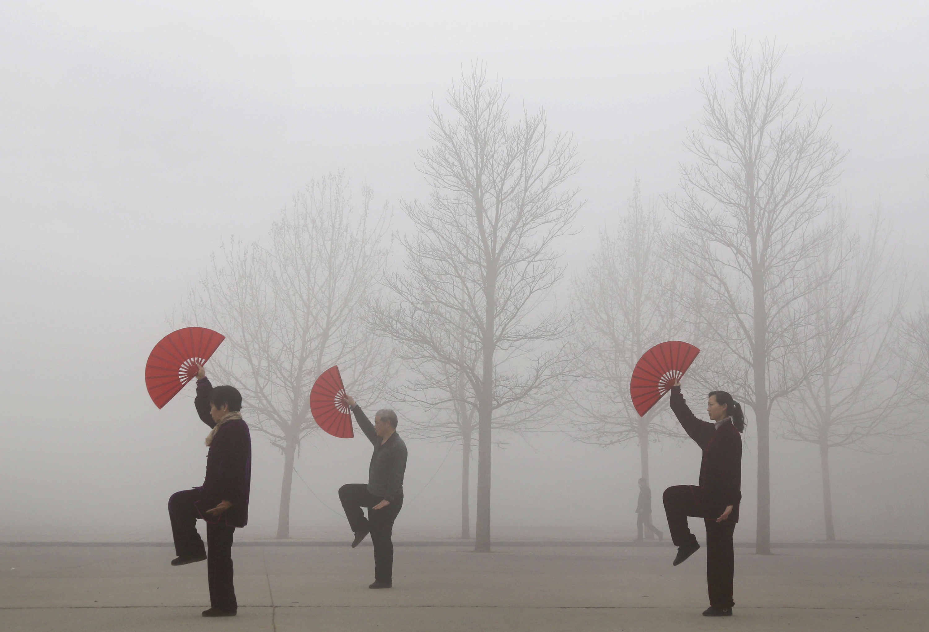 People do morning exercises on a polluted day in Jiaozuo, Henan province, China, on March 16, 2015