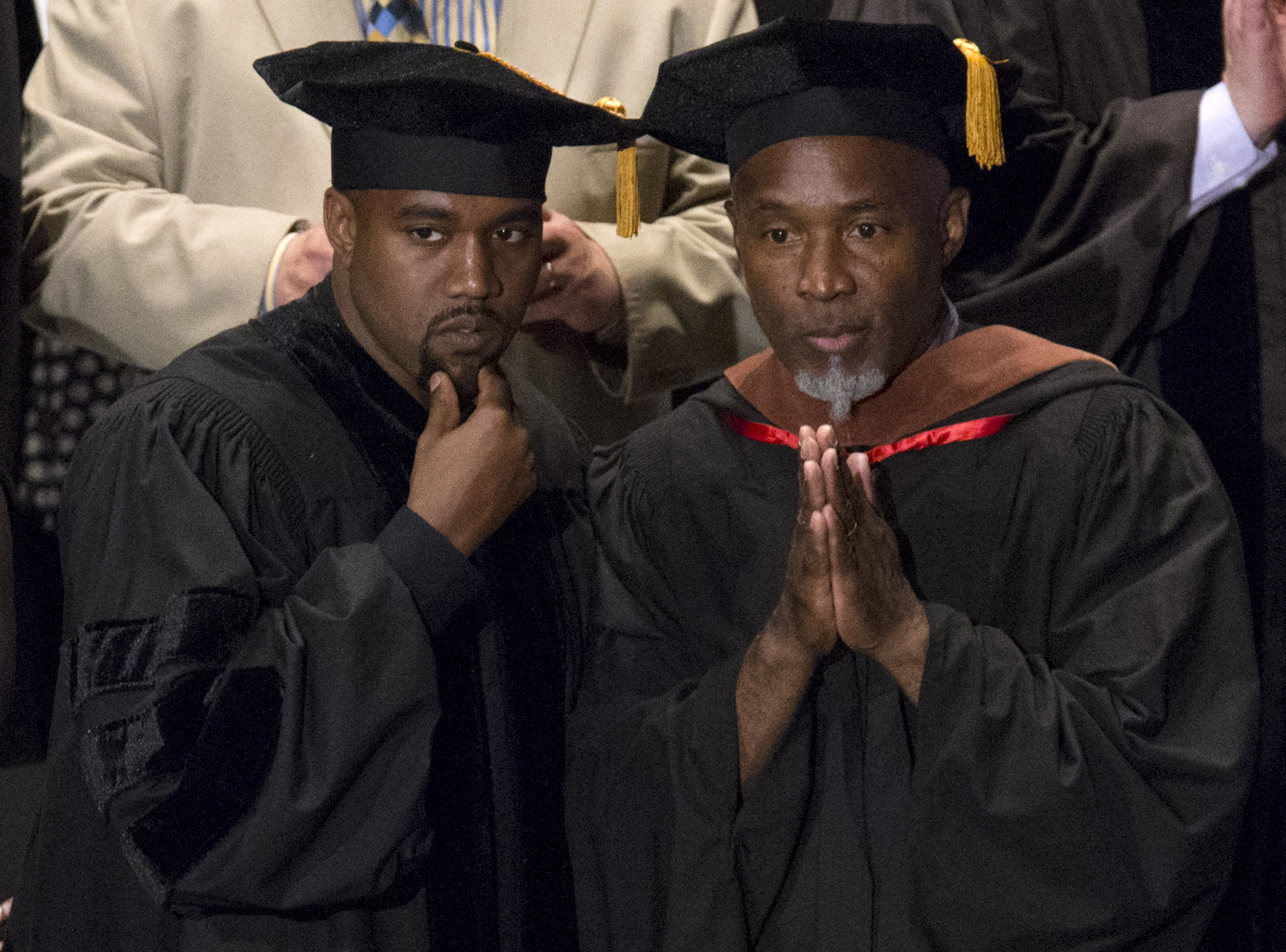 Musician Kanye West and School of the Art Institute of Chicago Professor Nick Cave attend the school's annual commencement ceremony where West received an honorary doctorate degree in Chicago, Illinois on May 11, 2015