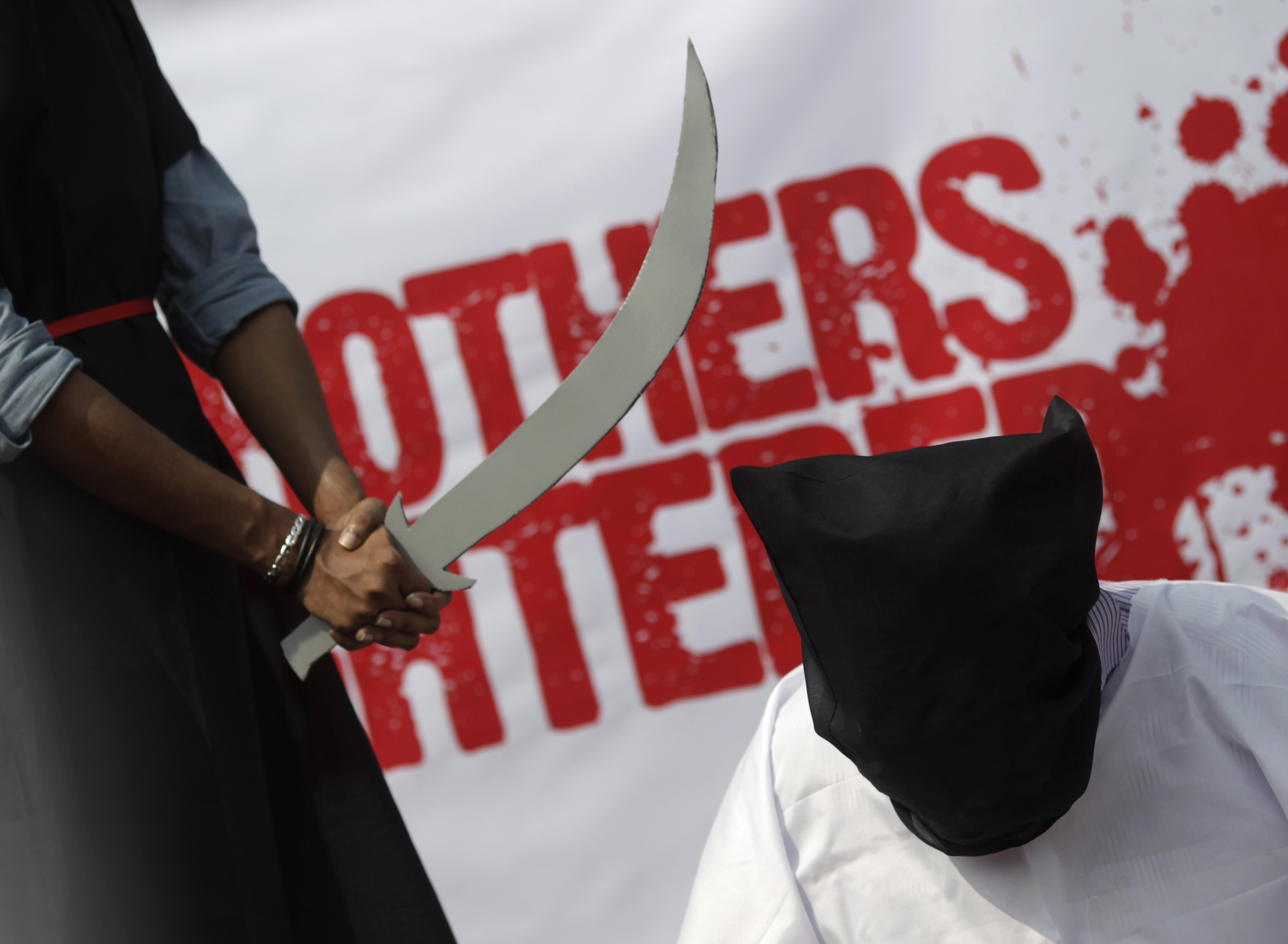 A mock execution scene in protest of Saudi Arabia beheadings in Dhaka, Bangladesh, on Oct 15, 2011