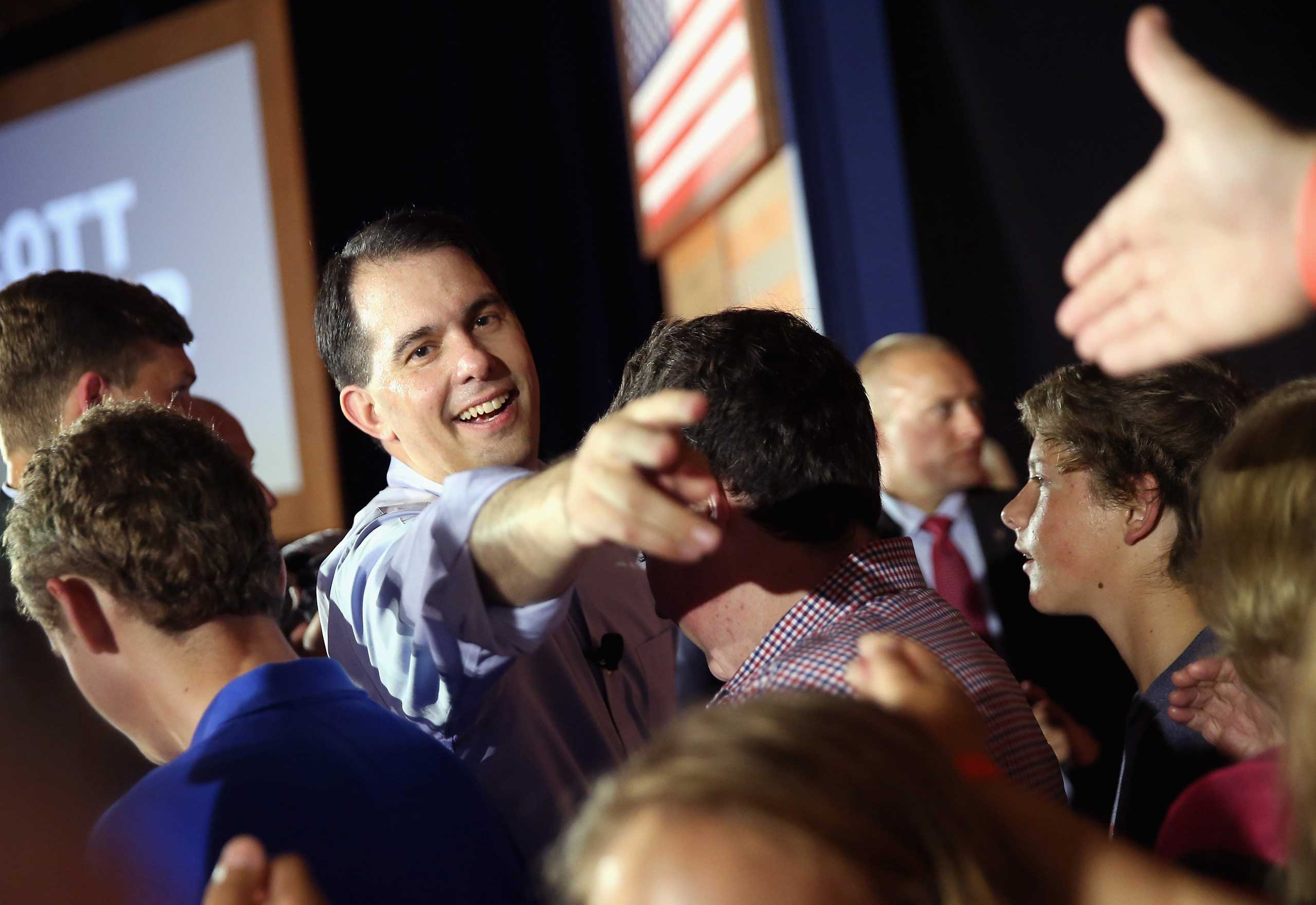 Wisconsin Governor Scott Walker greets supporters after announcing that he will seek the Republican nomination for president in Waukesha, Wis. on July 13, 2015 .