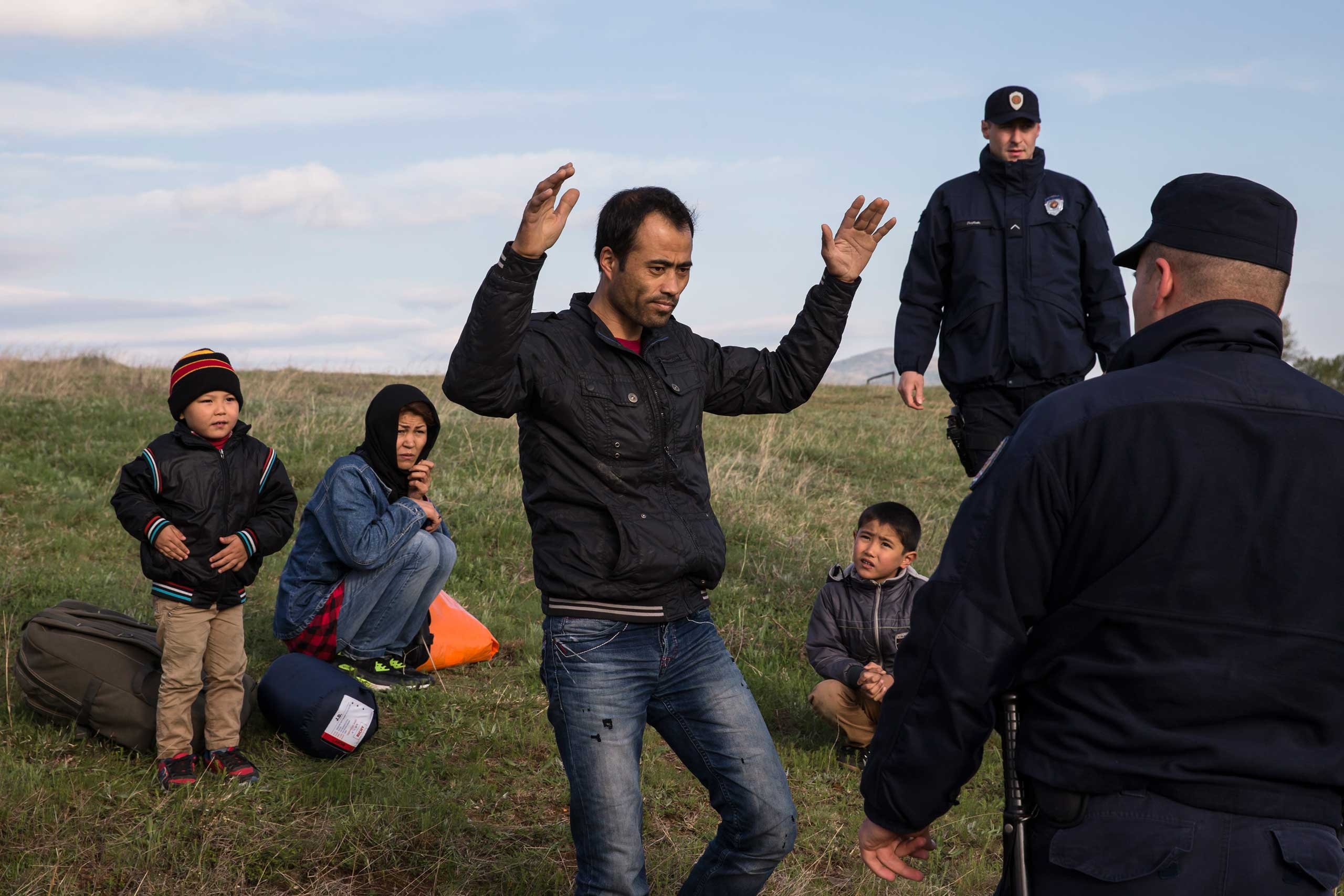 Migrants, who said they were from Afghanistan, sit on a ground after being apprehended by the Serbian border police for having illegally entered the country from Macedonia, near the town of Presevo some 240 miles from capital Belgrade, Serbia on April 29, 2015.