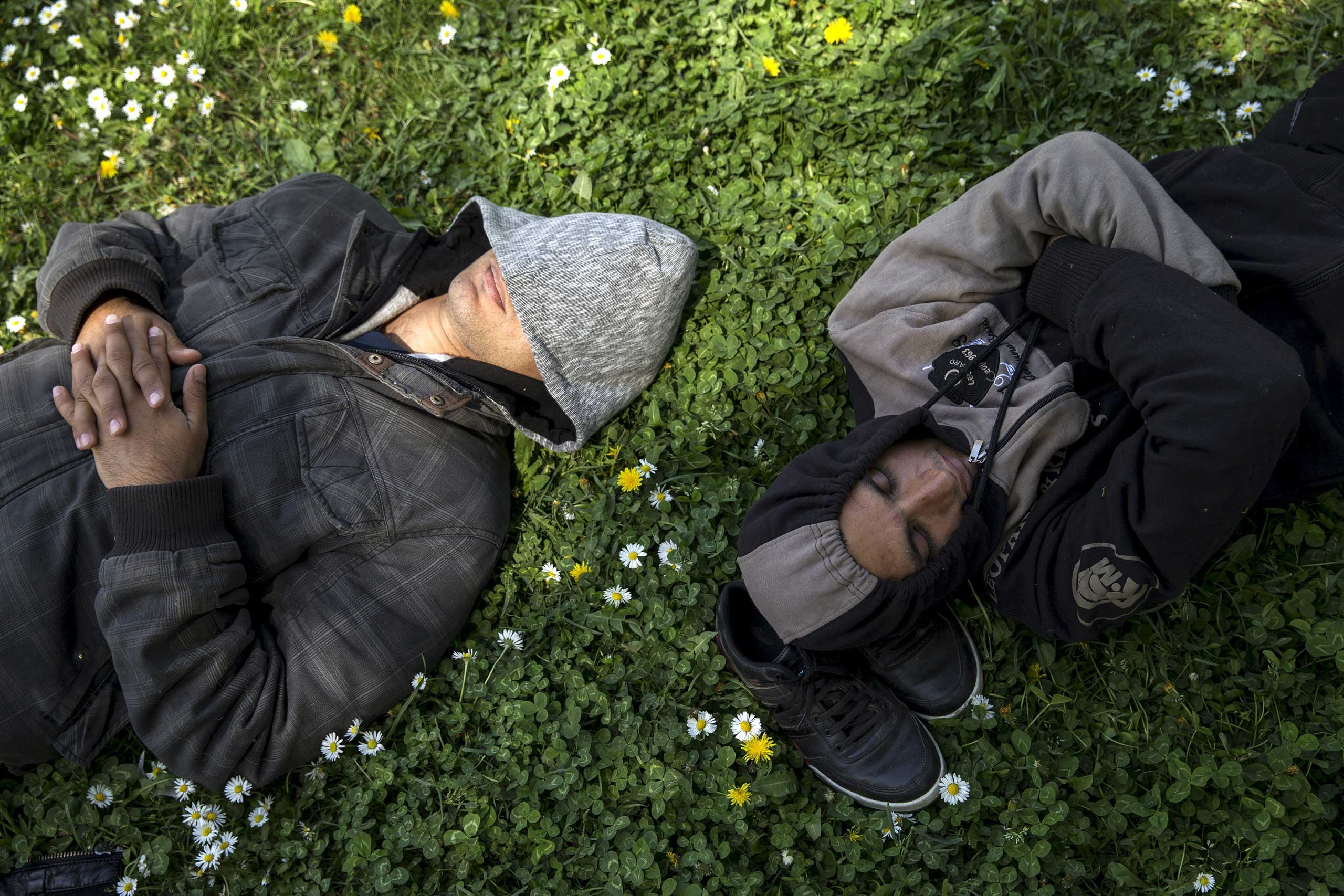 Migrants sleep in a park near the main Belgrade's bus and train station, Serbia on April 24, 2015.