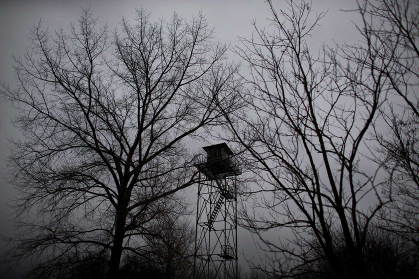 A watchtower left over from the Cold War era is seen meters away from the Serbian border with Hungary close to Kelebija, 90 miles north of Belgrade, Serbia on Feb. 26, 2015,