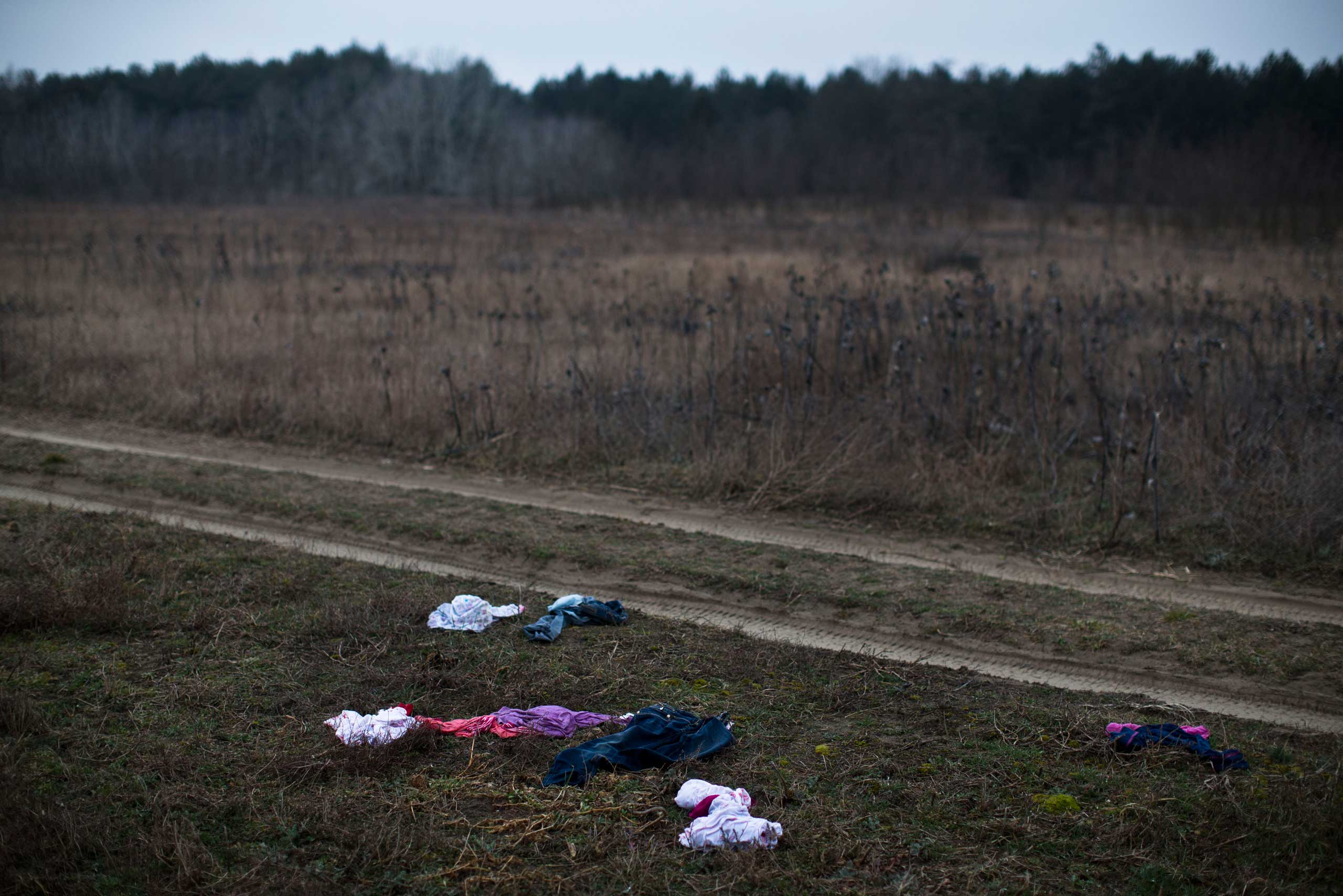 Discarded children's clothes are seen laying in a field meters away from the Serbian border with Hungary close to Horgos, 90 miles north of Belgrade, Serbia on Feb. 26, 2015.