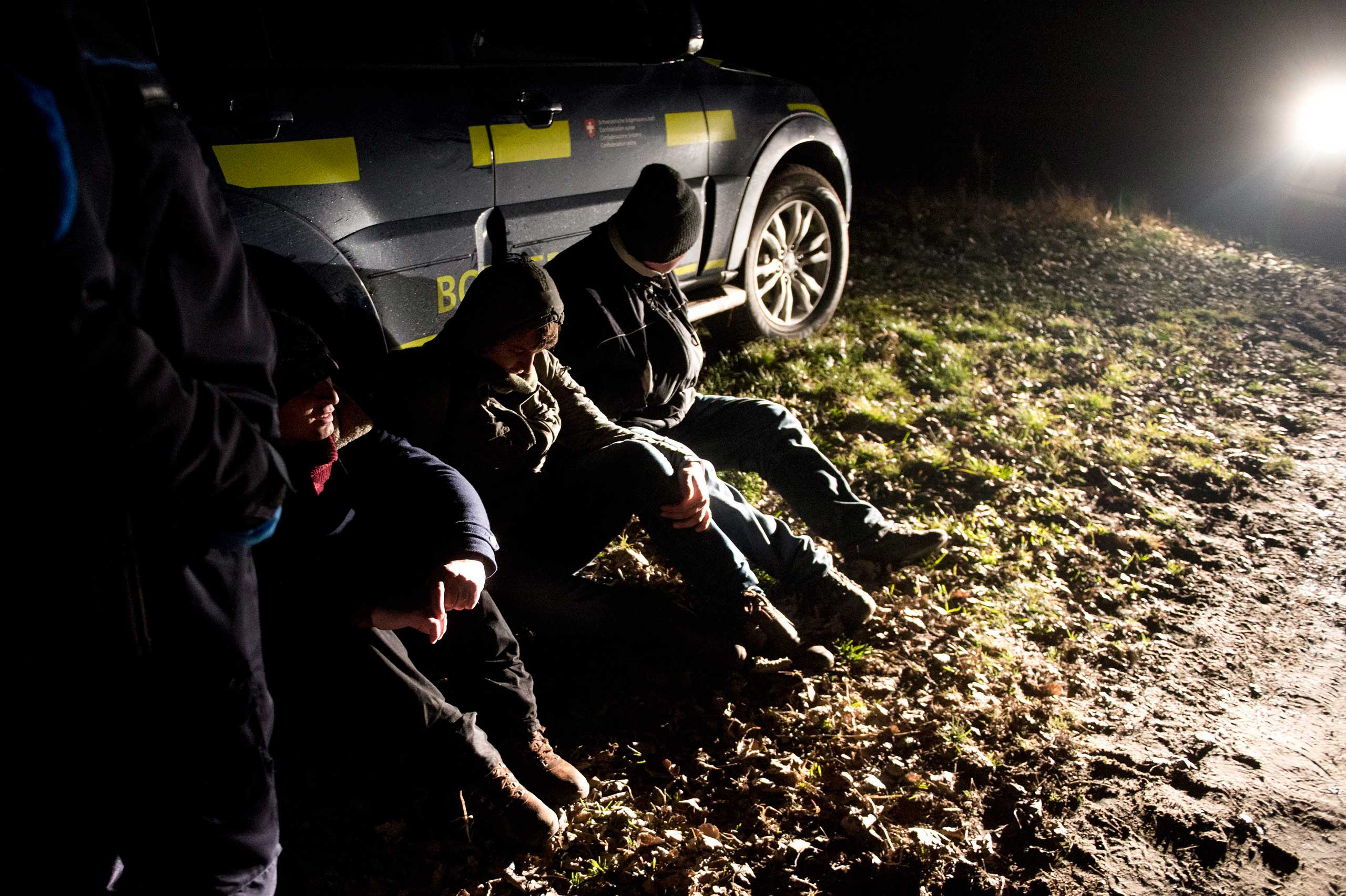 Migrants are detained by a Hungarian civil guard after being caught on the Hungarian-Serbian border near Roszke, south of Szeged, 100 miles south of Budapest, Hungary on Jan. 19, 2015.