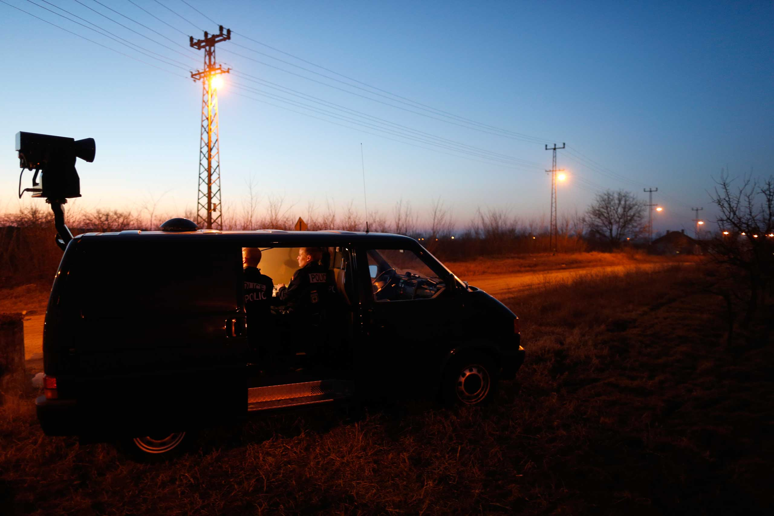 Members of the German border police sit in a van as they check a security camera while monitoring a stretch of the Serbian border with Hungary in the village of Hajdukovo, some 110 miles north of Belgrade, Serbia on Feb. 13, 2015.