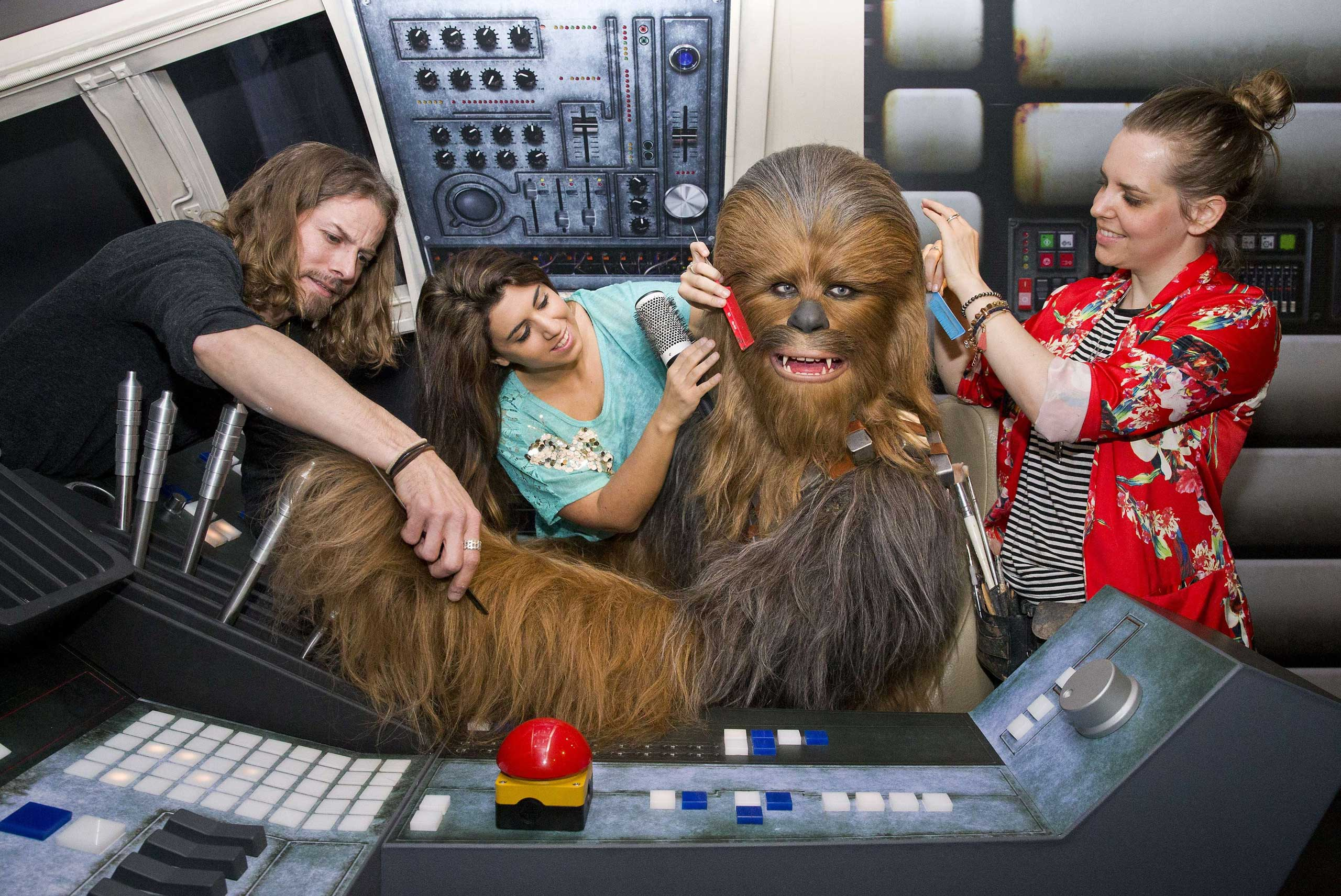 Members of staff put the finishing touches to the wax figure of Star Wars character Chewbacca at the Star Wars At Madame Tussauds attraction in London on May 12, 2015.