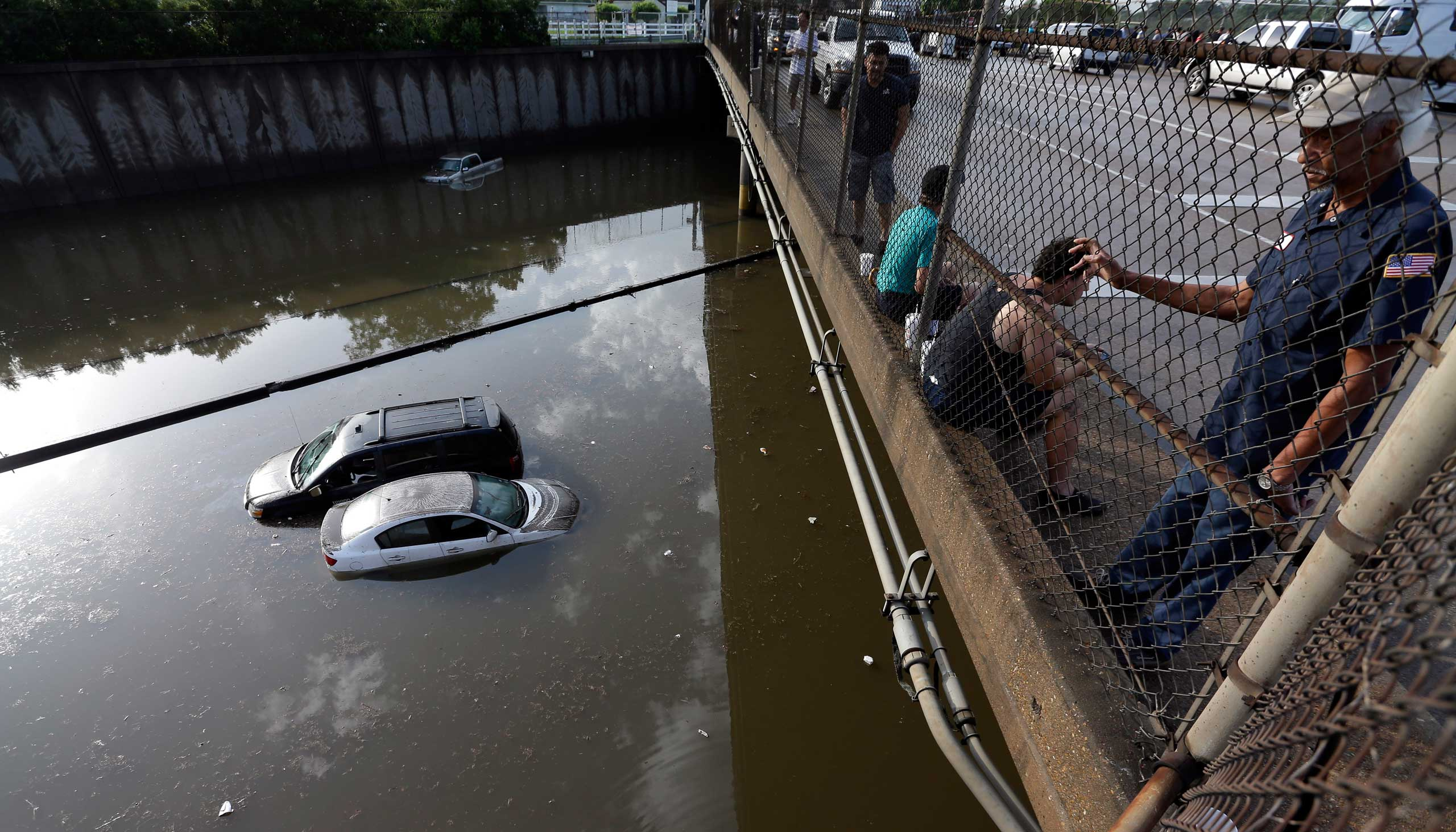 Cars sit in floodwaters along Interstate 45 after heavy overnight rain flooded parts of the highway in Houston on May 26, 2015.