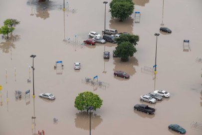 The parking lot of a Wal-Mart is submerged after the San Marcos River flooded in San Marcos, Texas on May 24, 2015.