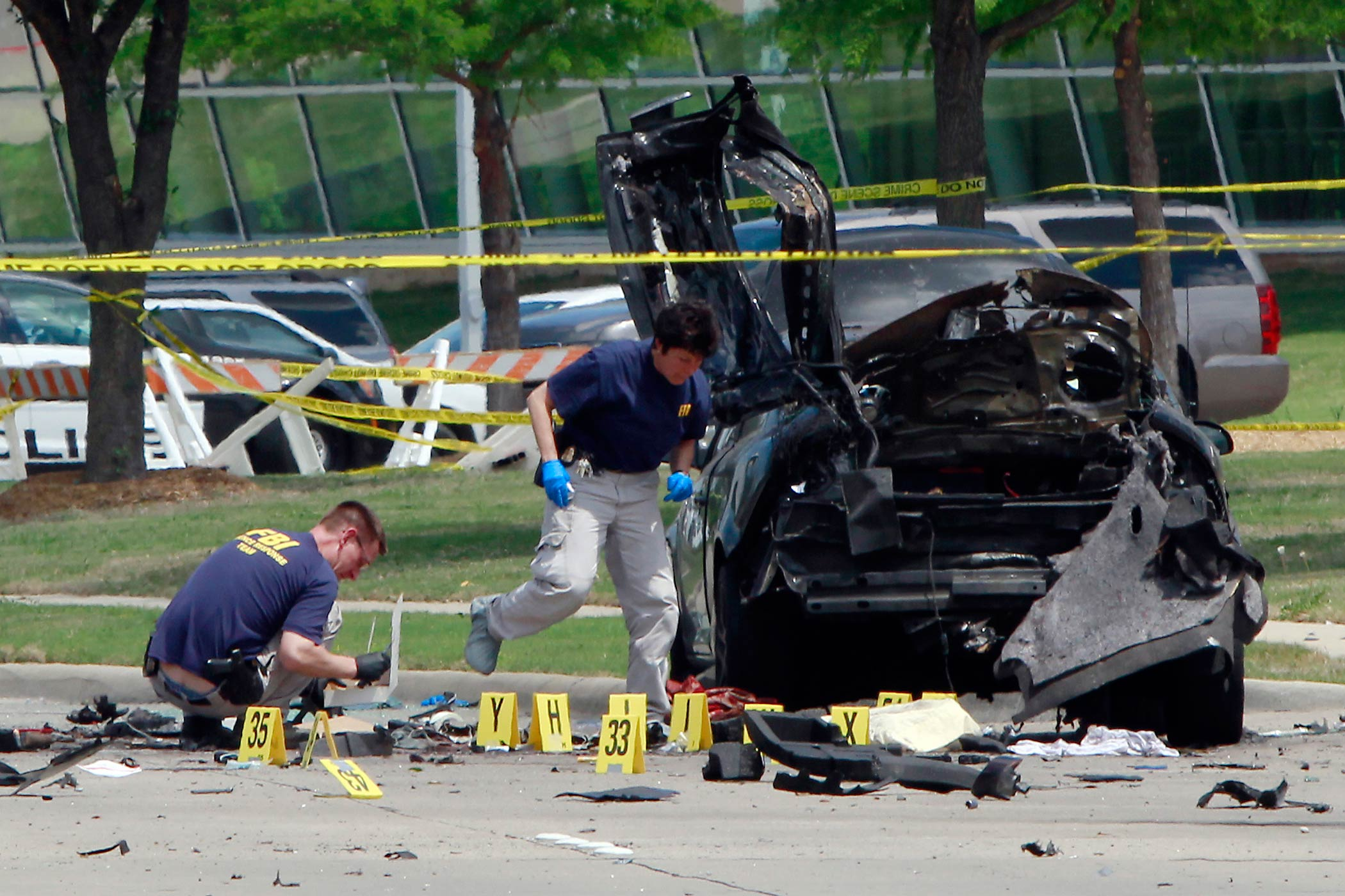 FBI investigators work a crime scene outside of the Curtis Culwell Center on May 04, 2015 in Garland, TX.