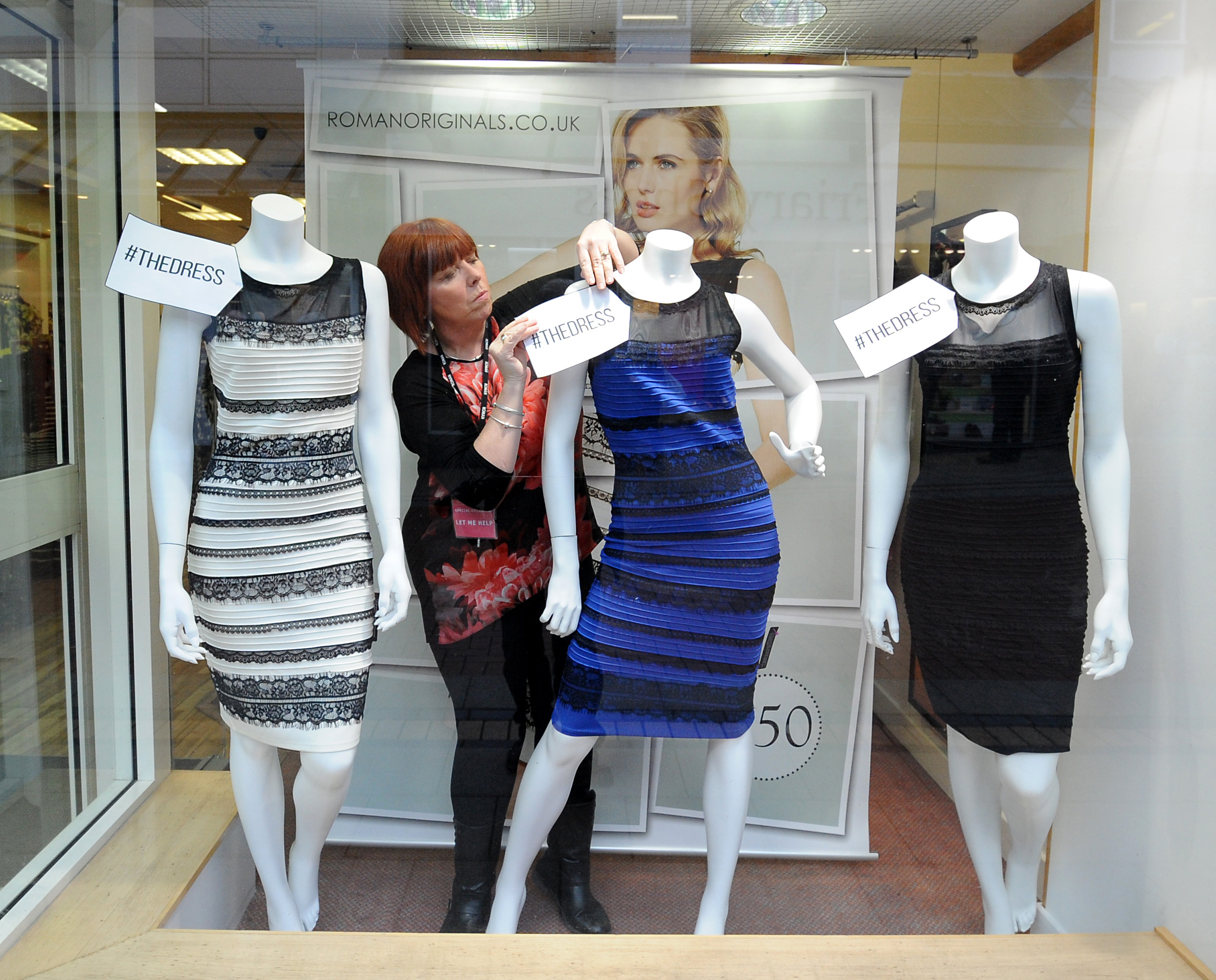 Shop manager Debbie Armstrong adjusts a two tone Roman Originals dress in a window display at a Roman Originals shop in Lichfield, England on Feb. 27, 2015.