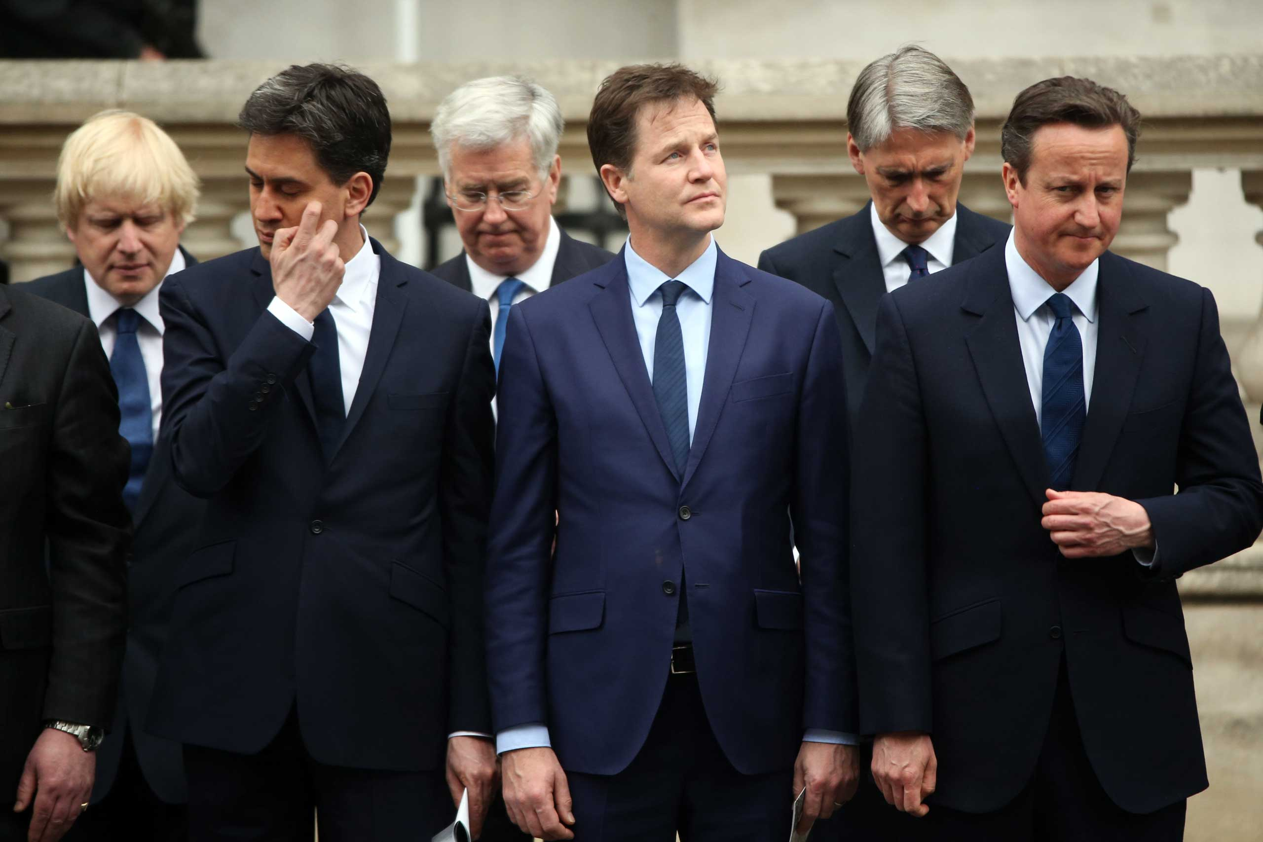 Labour Party leader Ed Miliband, Liberal Democrat leader Nick Clegg and Prime Minister David Cameron stand during a tribute at the Cenotaph to begin three days of national commemorations to mark the 70th anniversary of VE Day on May 8, 2015 in London.
