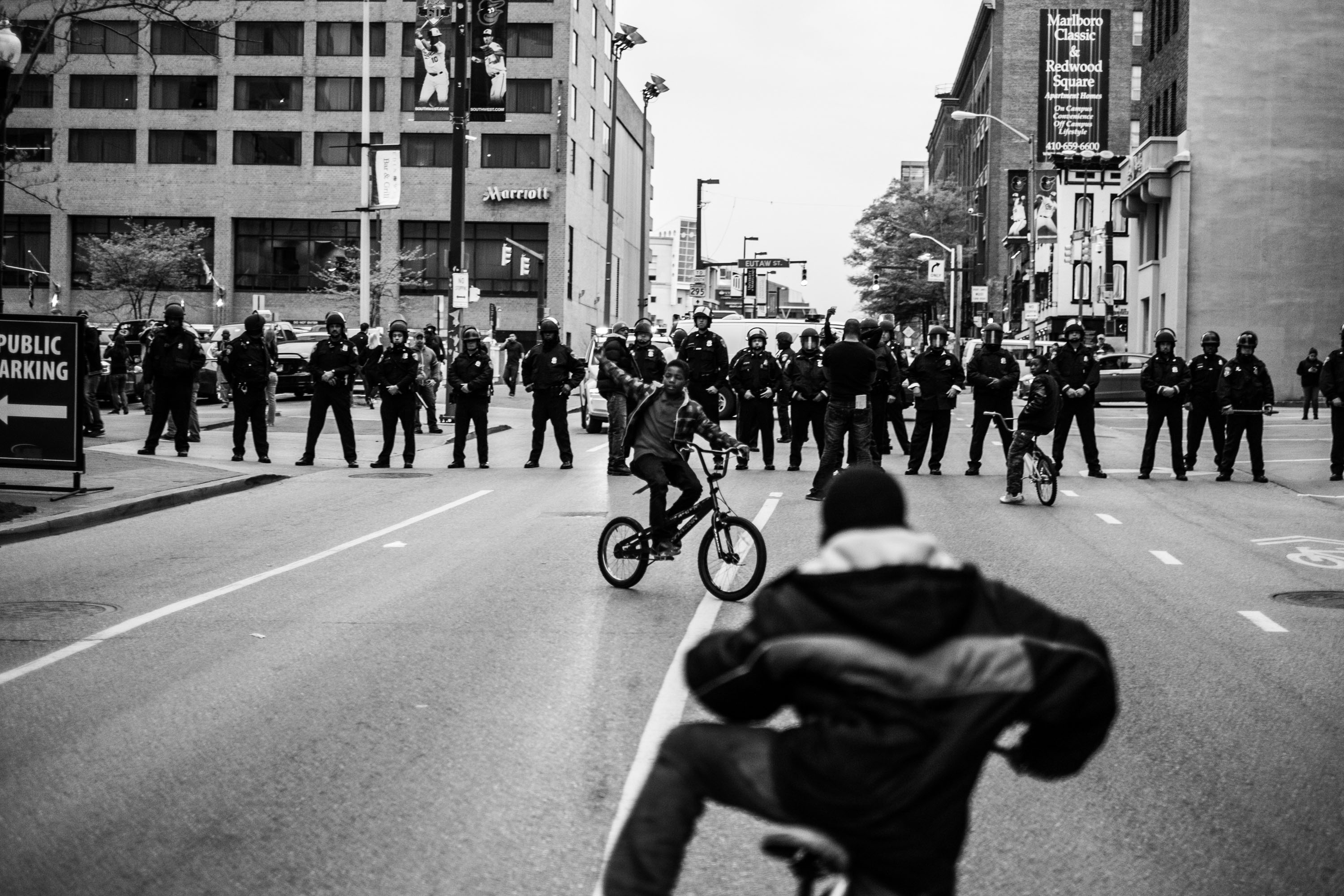Children bike near a police barricade in downtown Baltimore during a May2 protest.