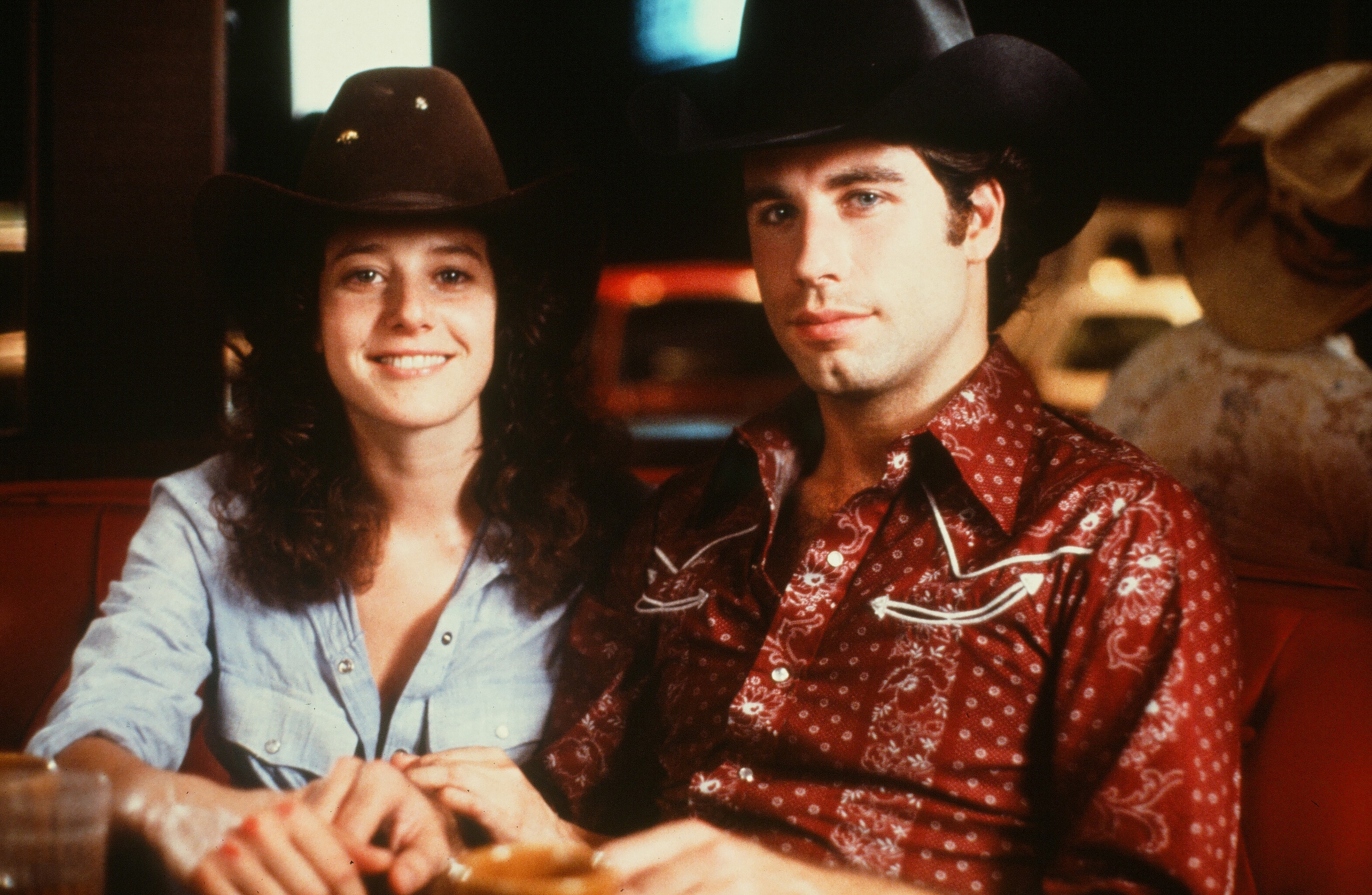 Actor John Travolta and Debra Winger pose in a scene during the Paramount Pictures movie  'Urban Cowboy  circa 1980.