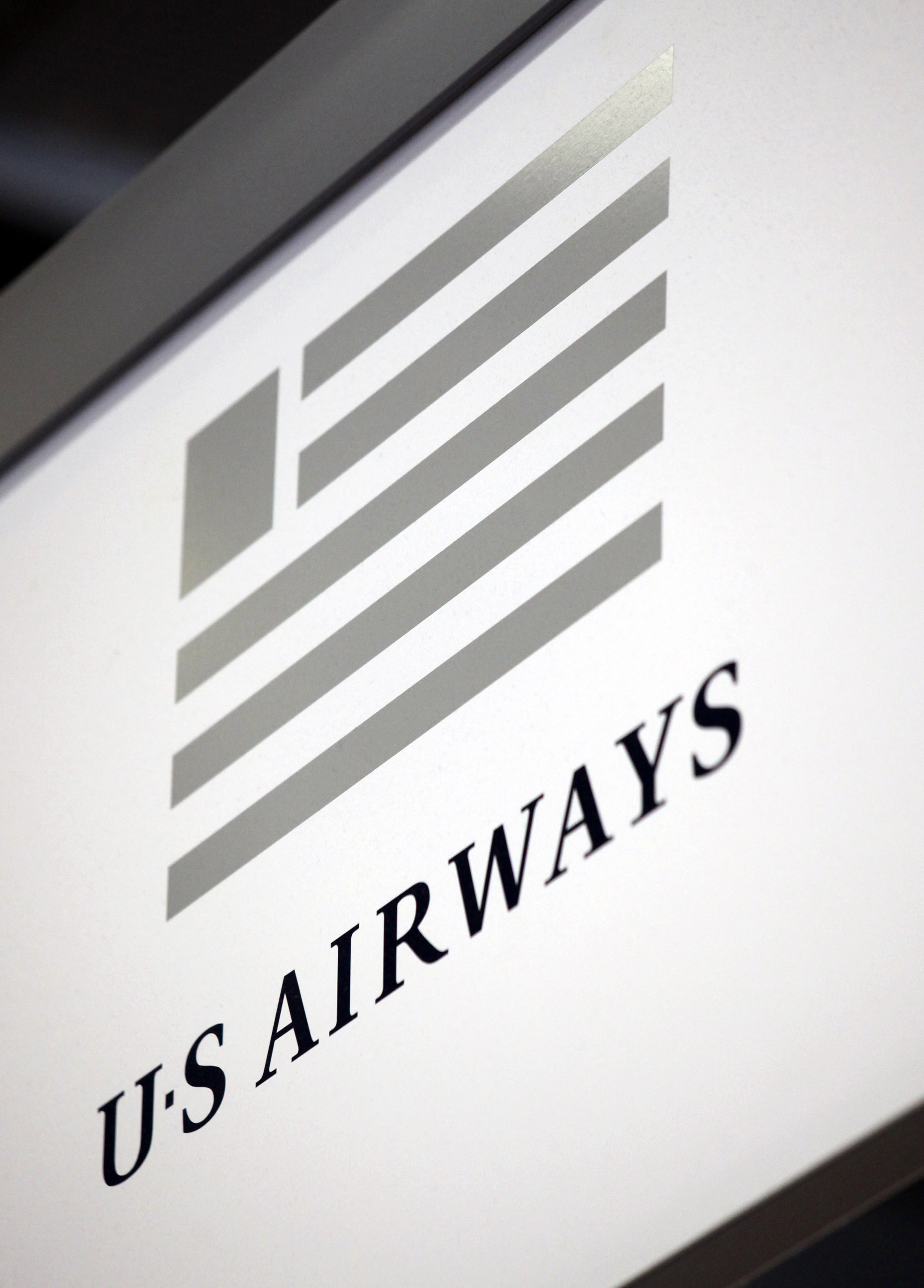 The US Airways logo hangs near a ticket counter at O'Hare International Airport in Chicago, on April 8, 2010.
