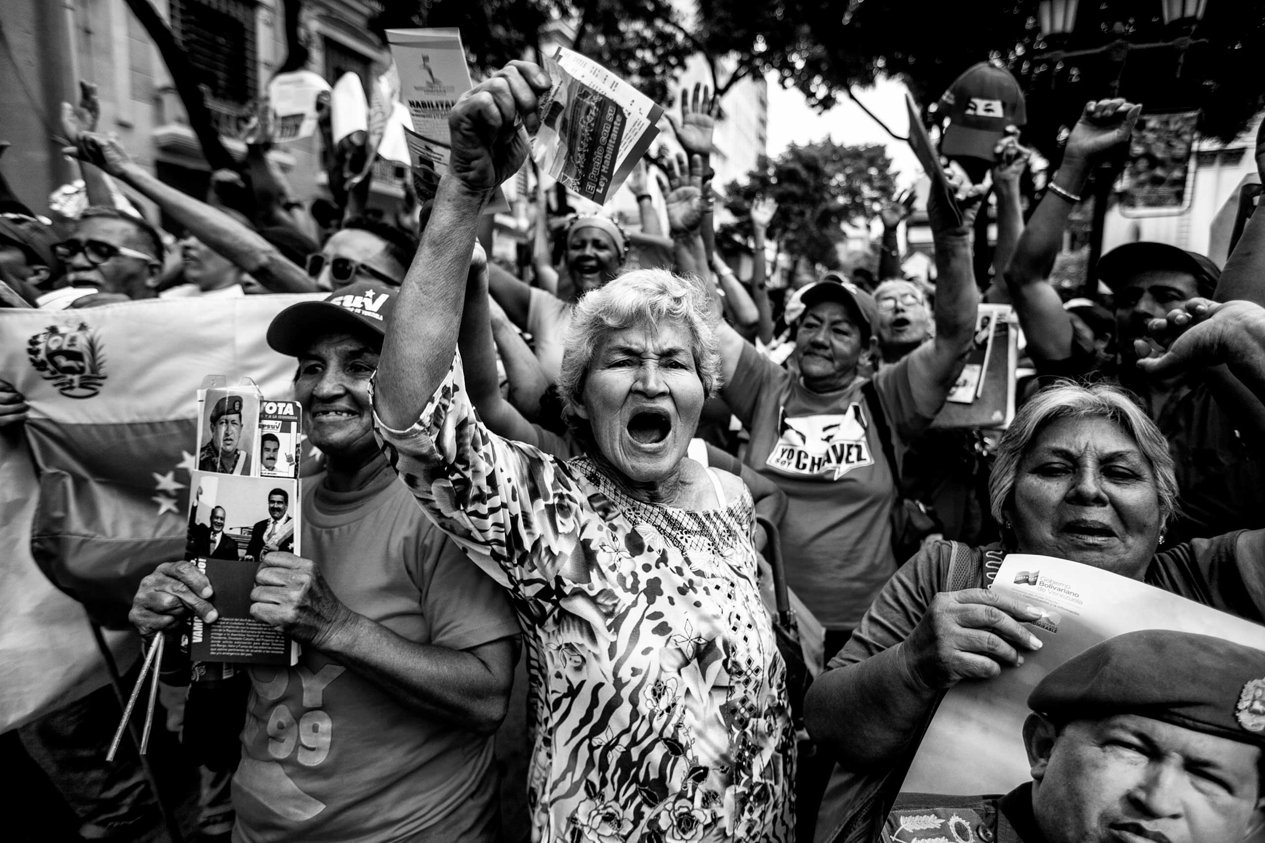 Women shout slogans against Venezuela's opposition during a political rally in front of the national parliament. Caracas, November 2013.