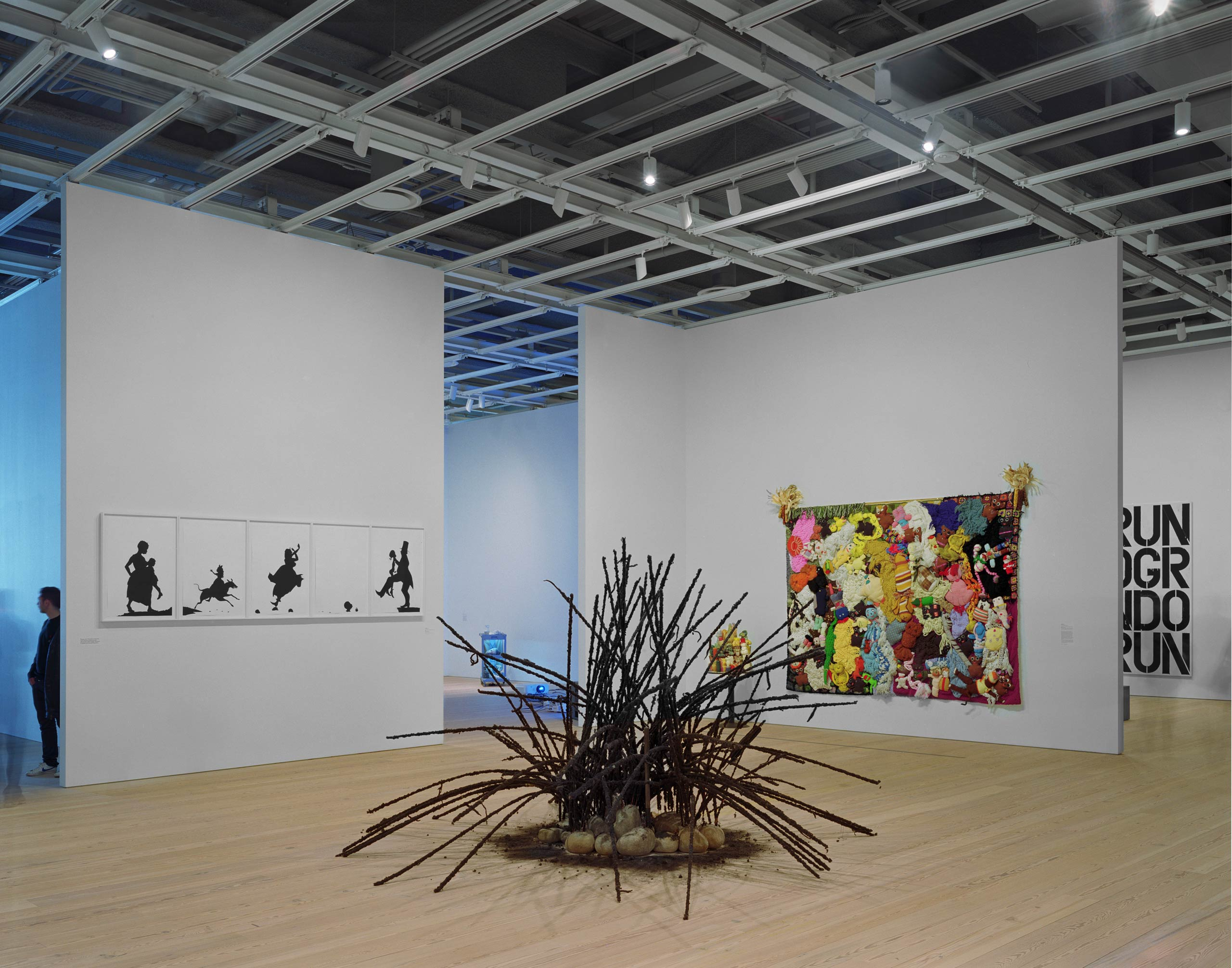 Artwork from left to right: Kara Walker, A Means to an End... A Shadow Drama in Five Acts, 1995; (foreground) David Hammons, untitled, 1992; Mike kelley, More Love Hours Than Can Ever Be Repaid and The Wages of Sin, 1987