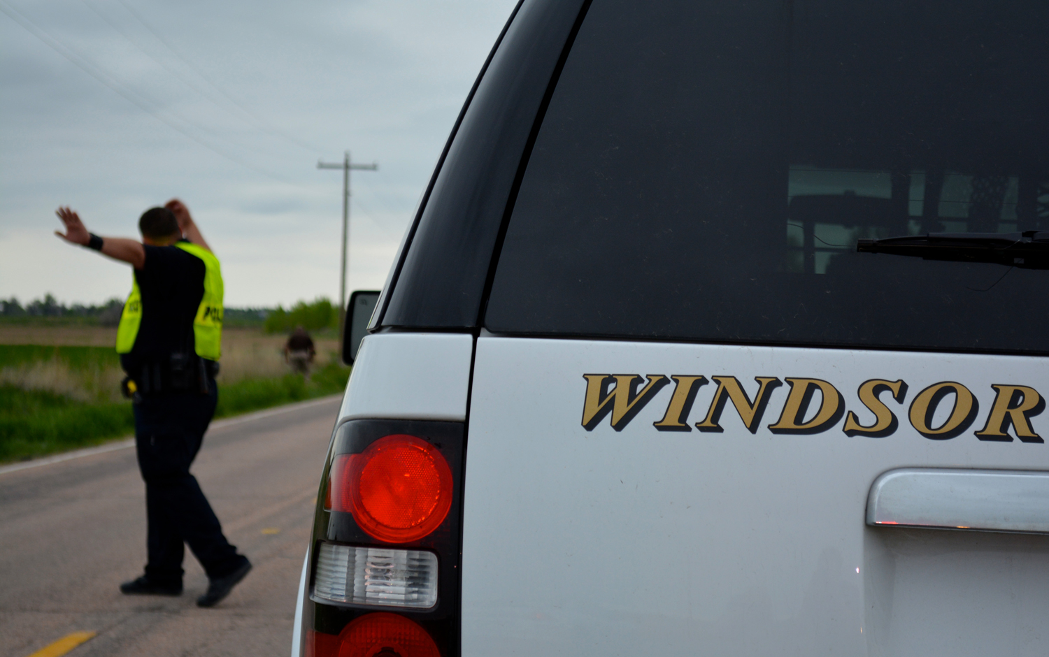 Windsor Police investigate the area where a cyclist was fatally shot in Windsor, Colo.