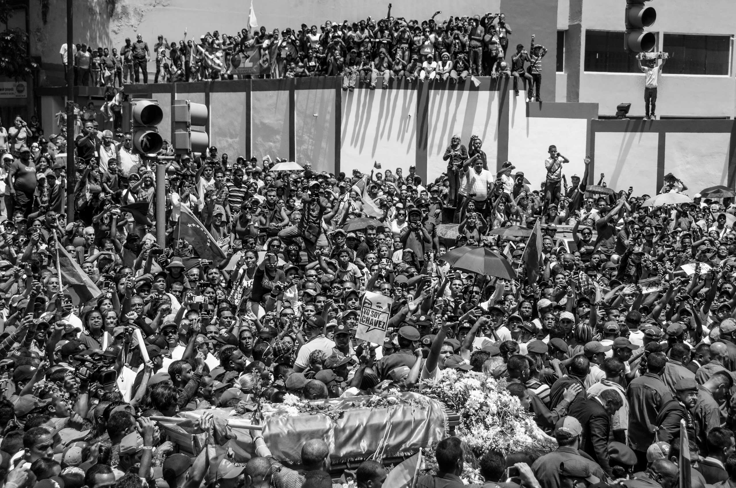 The coffin of former President Hugo Chávez is surrounded by thousands of people the day after he died. Caracas, March 2013.