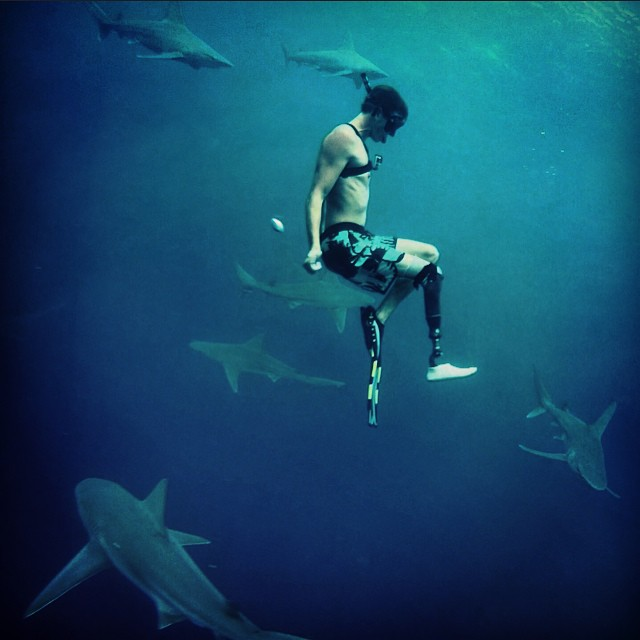 An image of Mike Coots taken by his friend Juan Oliphant as they are swimming surrounded by sharks.