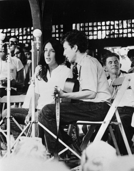 Folk singers Joan Baez, and Bob Dylan perform at the Newport Jazz Festival in Newport, R.I. in 1963.